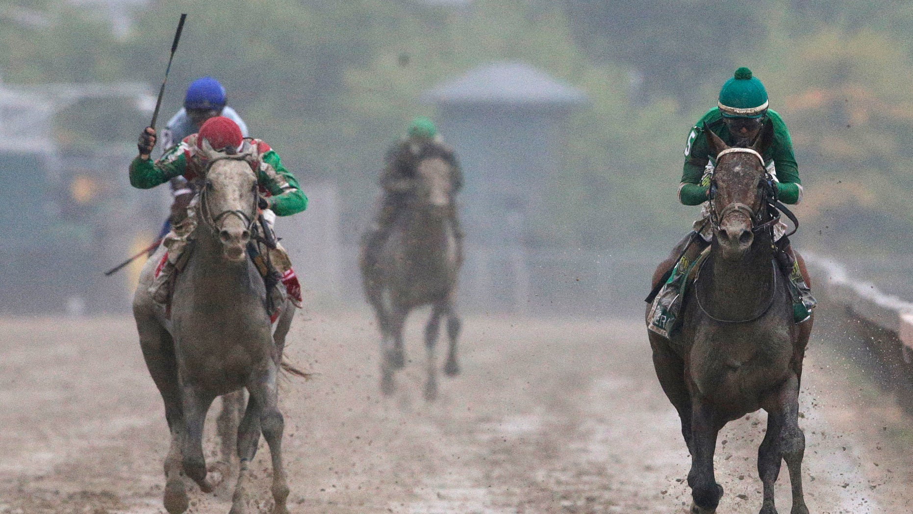 Exaggerator, right, with Kent Desormeaux aboard wins the 141st Preakness Stakes horse race at Pimlico Race Course, Saturday, May 21, 2016, in Baltimore. Cherry Wine, left, with Corey Lanerie aboard places second. (AP Photo/Patrick Semansky)