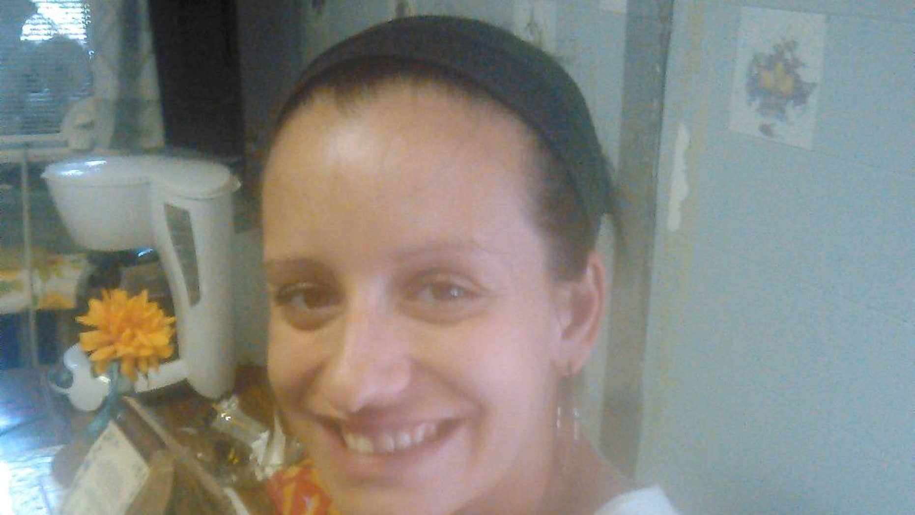 In this undated photo provided by Judith Luckangelo, 25-year-old Megan Doto is show in Philadelphia. Police say on Sunday, Aug. 24, 2014, a bullet struck and killed the 25-year-old Doto, who was eight months pregnant. Doto died less than two hours later. Her child died early Monday at Temple University Hospital. A $40,000 reward is being offered in the deaths of a Luckangelo and her child. Philadelphia Homicide Capt. James Clark says a man dressed in black fired more than 10 shots at a car a block away Sunday morning. (AP Photo/Judith Luckangelo)