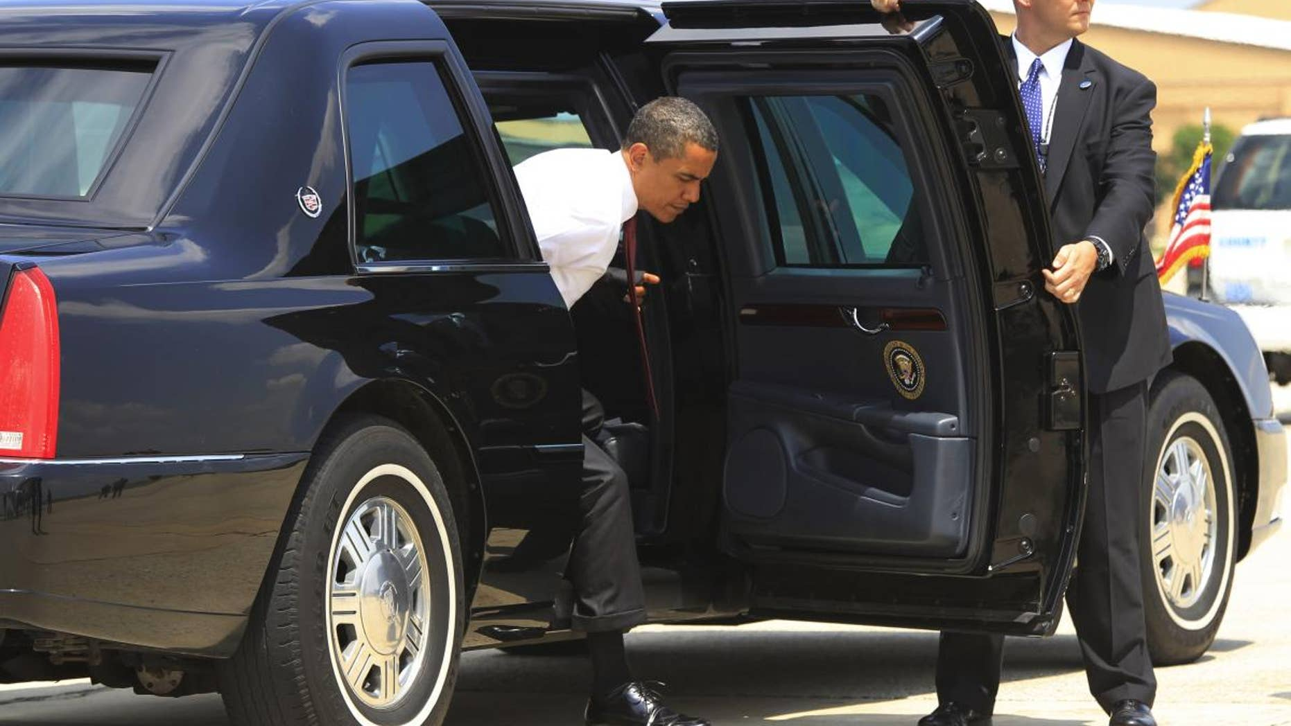 President Barack Obama steps out of the armored presidential limousine at Andrews Air Force Base. (AP File Photo/Charles Dharapak)