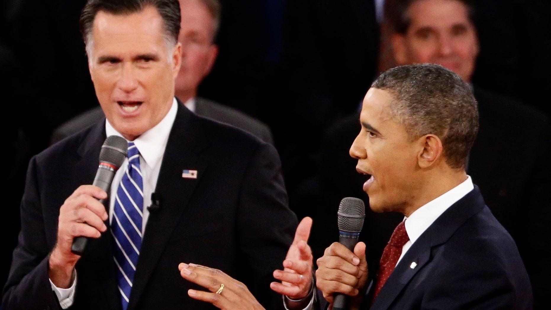FILE: Oct. 16, 2012.: President Obama and Republican presidential nominee Mitt Romney in the second presidential debate at Hofstra University in Hempstead, N.Y.