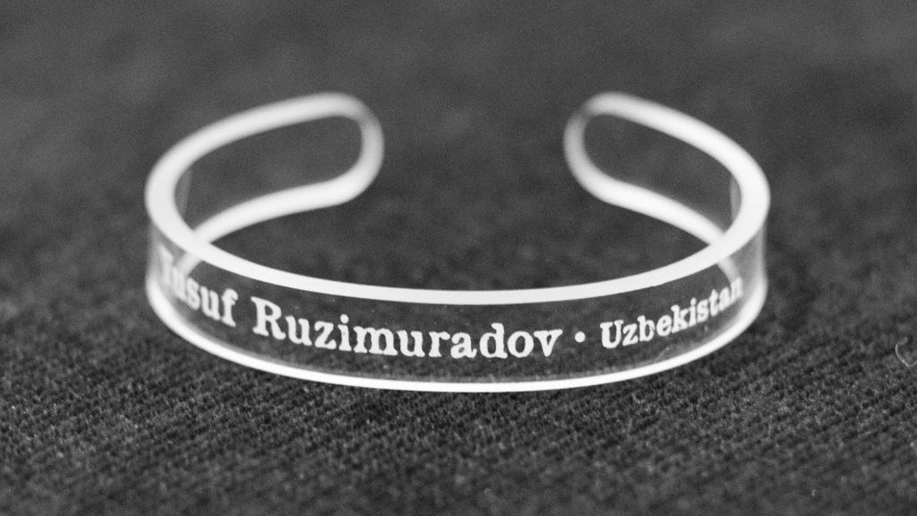 This handout photo provided by the Press Uncuffed Campaign shows a bracelet that University of Maryland journalism students are selling emblazoned with the names of journalists imprisoned around the world, to raise money for the cause, and awareness of their plight. The line includes 11 different bracelets, each with the name of a jailed journalist on it. The students are raising money to produce at least 10,000 bracelets.  (AP Photo/Press Uncuffed Campaign)