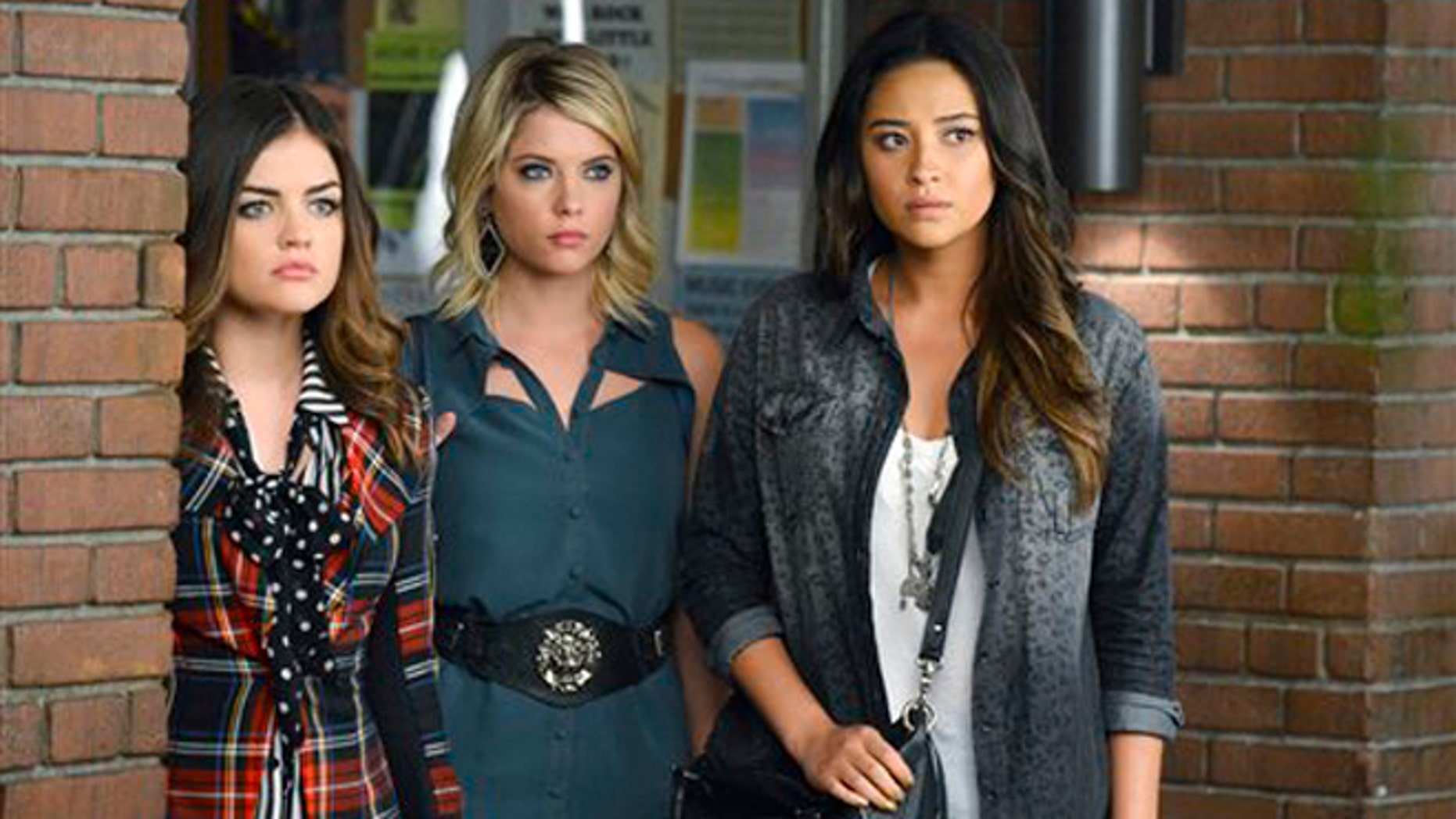 """This publicity image released by ABC Family shows, from left, Lucy Hale, Ashley Benson and Shay Mitchell in a scene from """"Pretty Little Liars.""""  On Tuesday, March 26, 2013, ABC Family approved a new series called """"Ravenswood,"""" a spin-off of """"Pretty Little Liars."""" (AP Photo/ABC Family, Eric McCandless)"""