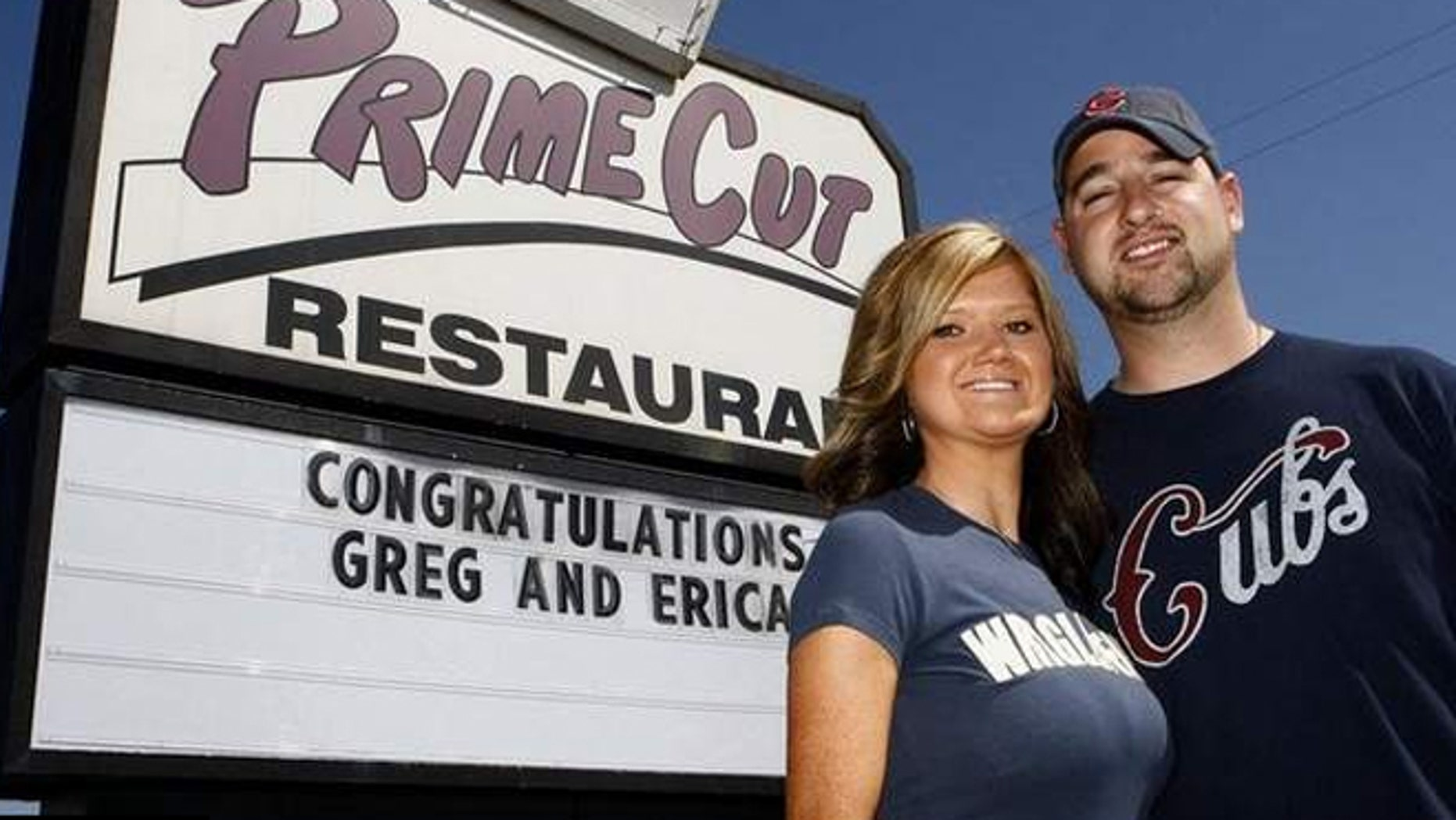 Greg Altringer proposed to his girlfriend Erica Kresge the old-fashioned way after she missed the message on a scoreboard at Wrigley Field.