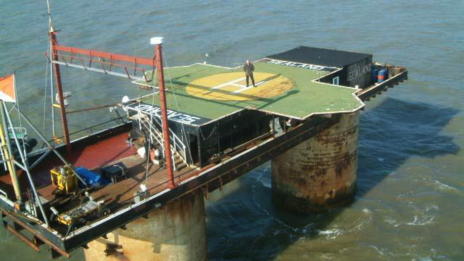 "Prince Michael Bates of Sealand stands atop the helipad on his World War II era ""micronation"" -- a possible future location for Wikileaks' servers."