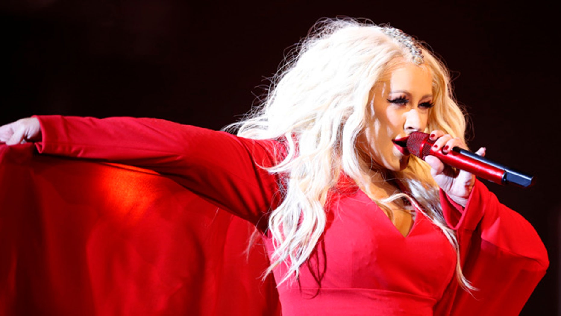 FILE - In this May 28, 2016 file photo, Christina Aguilera performs during a concert at the annual Mawazine Music Festival in Rabat, Morocco. Aguilera, Stevie Wonder, and members of Prince's inner circle will highlight a family-sanctioned Prince tribute concert in St. Paul on Oct. 13, 2016. The lineup also includes Chaka Khan, John Mayer, Tori Kelly, Anita Baker, Doug E. Fresh, Luke James, Bilal and Mint Condition. (AP Photo /Abdeljalil Bounhar, File)
