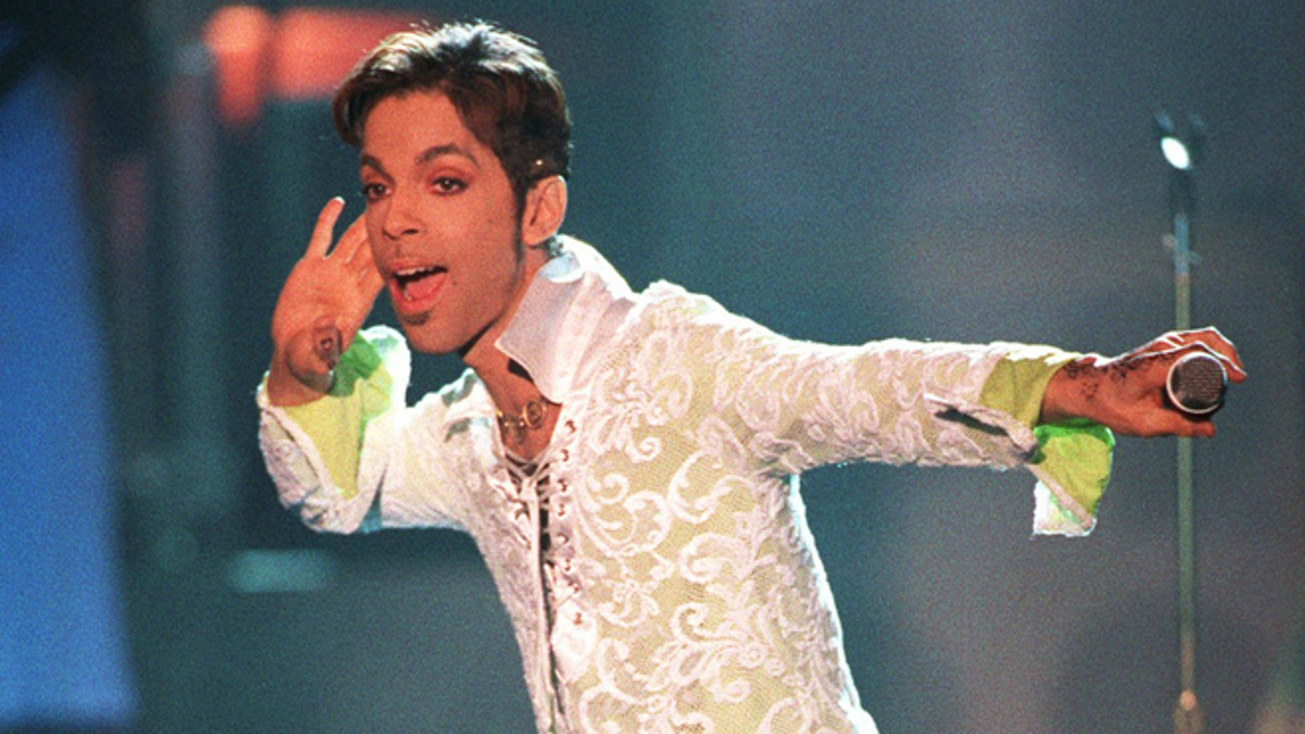 "FILE - In this April 10, 1997 file photo, Prince performs a medley of ""Take Me With U"" and ""Rasberry Beret"" at the 4th annual VH1 Honors in Universal City, Calif. Prince's publicist has confirmed that Prince died at his home in Minnesota, Thursday, April 21, 2016. He was 57. (AP Photo/Mark J. Terrill, File)"