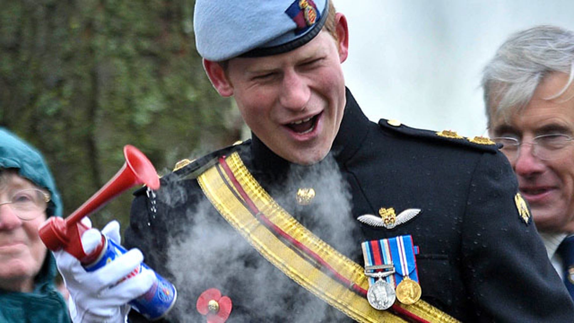 Nov. 9: Britain's Prince Harry laughs as an air horn given to him to start a military charity march malfunctions, during the opening of the Royal British Legion Field of Remembrance, at Wootton Bassett, England.