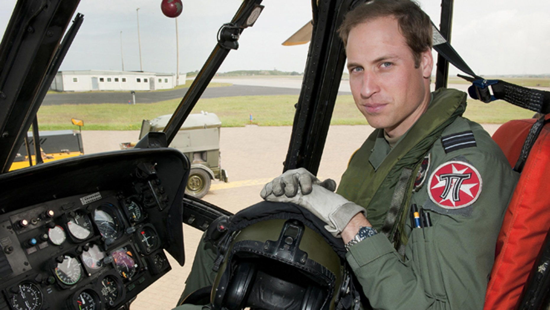 June 1, 2012: In this file photo released by Britain's Ministry of Defence , Britain's Prince William sits in the cockpit of a helicopter at RAF Valley in Anglesey Wales.