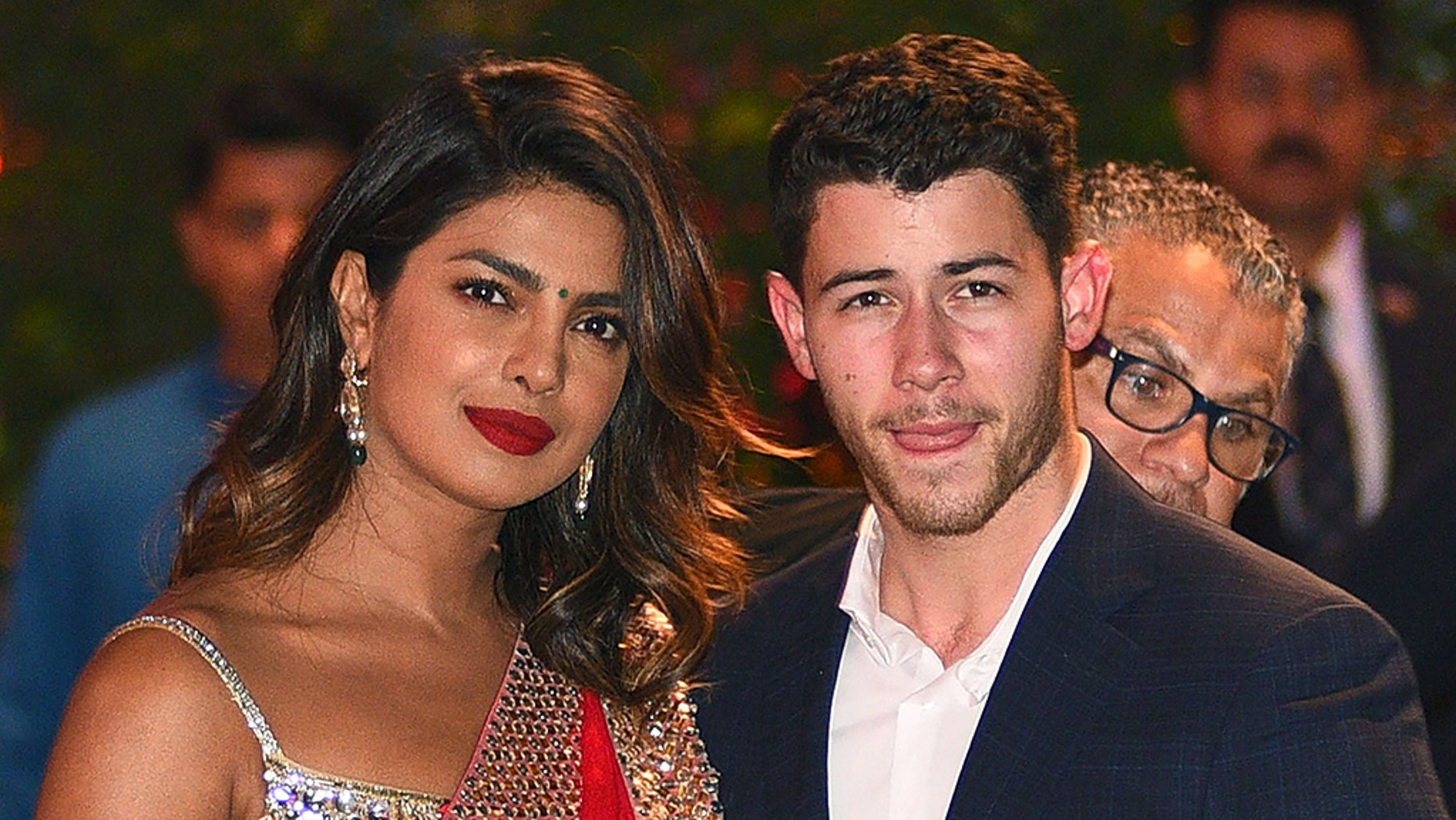 Indian Bollywood actress Priyanka Chopra (L) accompanied by Nick Jonas arrive for the pre-engagement party of India's richest man and Reliance Industries Limited Chairman, Mukesh Ambanis eldest son Akash Ambani and fiancee Shloka Mehta in Mumbai on June 28, 2018. (Photo by SUJIT JAISWAL / AFP)        (Photo credit should read SUJIT JAISWAL/AFP/Getty Images)