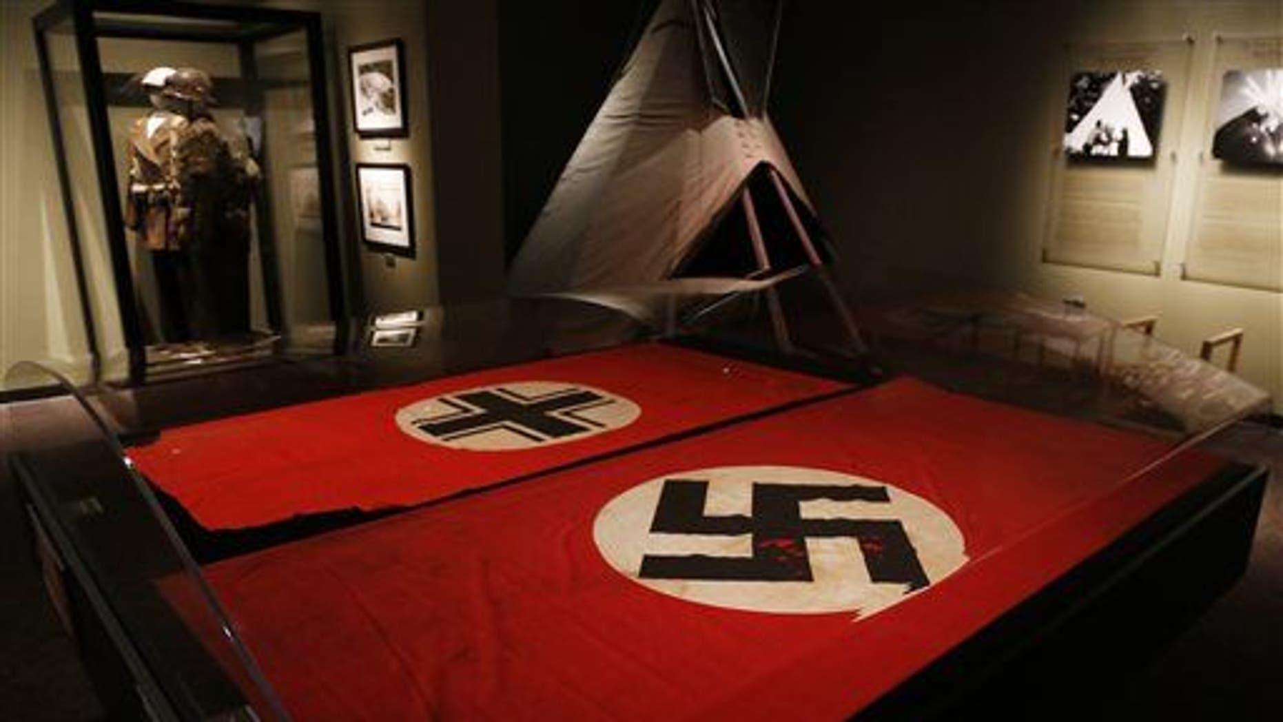 A Nazi German flag with the swastika.