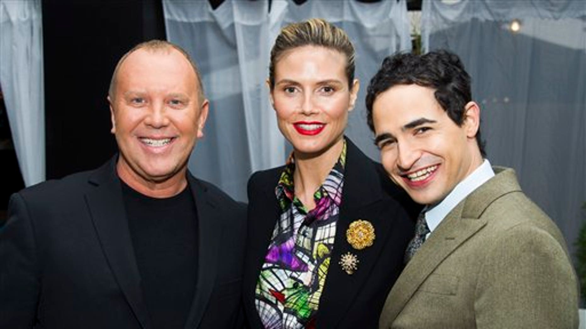 Michael Kors, from left, Heidi Klum and Zac Posen pose before the Fall 2013 Project Runway fashion show on Friday, Feb. 8, 2013 in New York. (Photo by Charles Sykes/Invision/AP)