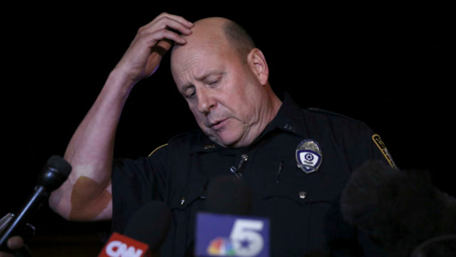 May 3, 2015: Garland Police spokesperson Joe Harn pauses as he addresses media about the shooting at the Curtis Culwell Center where a provocative contest for cartoon depictions of the Muslim prophet Muhammad was held in Garland, Texas. (AP Photo/LM Otero)
