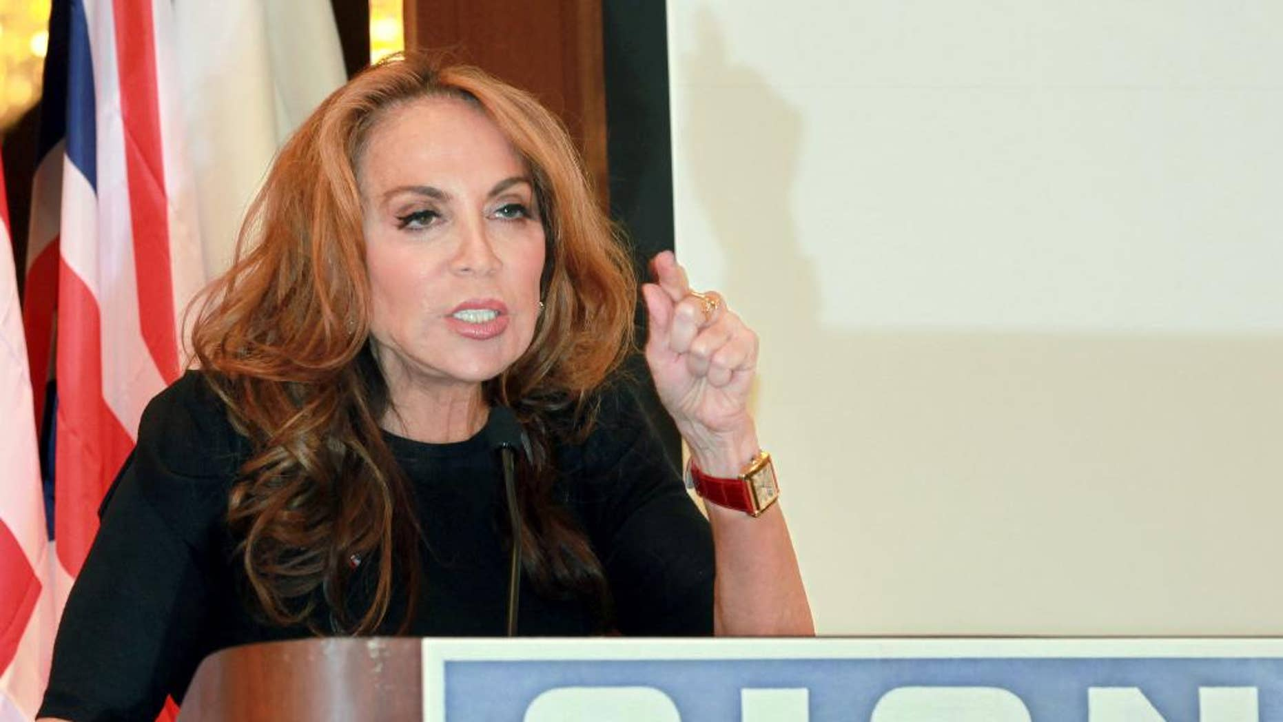 """In this Sept. 11, 2012 photo, blogger and activist Pamela Geller speaks at a conference she organized entitled """"Stop Islamization of America,"""" in New York. The New York Police Department met with Geller on Wednesday, May 6, 2015, after a threat against her was discovered on a website related to the Islamic State group. NYPD spokesman Stephen Davis said that the department will do a """"comprehensive threat assessment"""" to decide whether it's credible enough to require security for Geller. (AP Photo/David Karp)"""