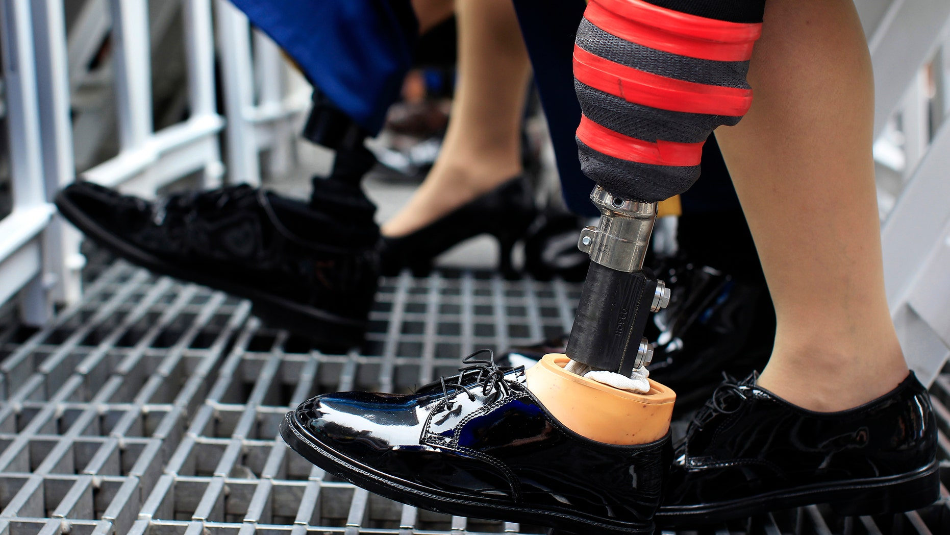Prosthetic legs are seen on U.S. Army soldiers attending the Army's 237th anniversary celebrations at Times Square in New York.