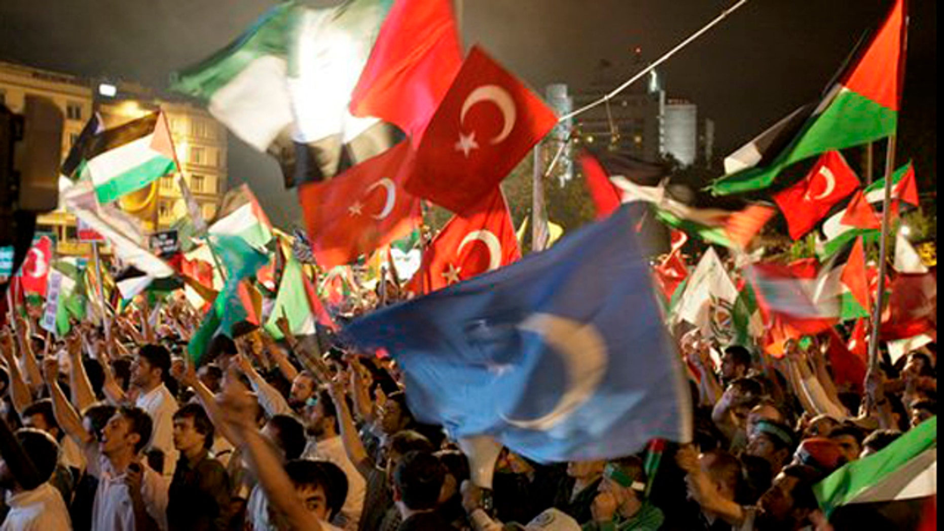 June 2, 2010: Demonstrators chant slogans waving Palestinian and Turkish flags during a protest against Israel, in Istanbul, Turkey.