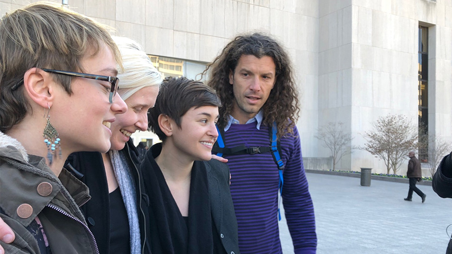 Four of the six acquitted Inauguration Day protesters, including Brittne Lawson (second to left) and Alexei Wood (far right), stood outside the courthouse following the verdict announcement.