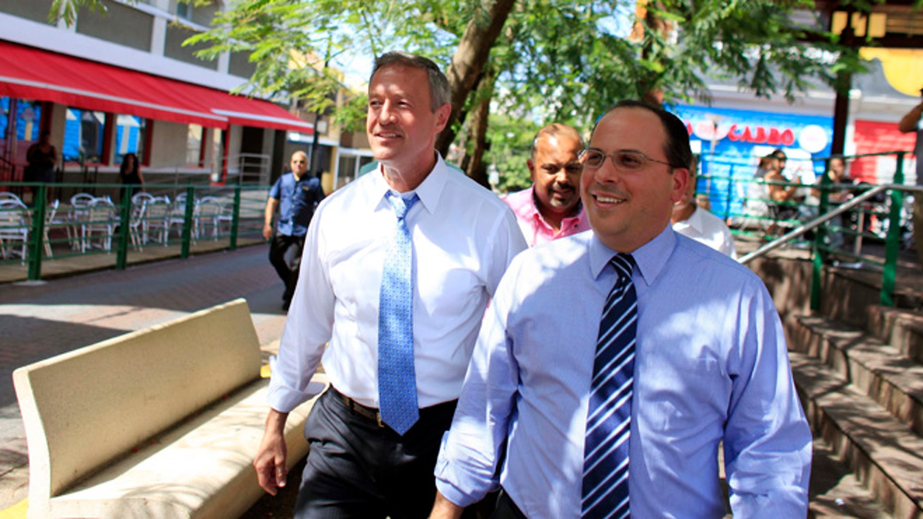 Democratic presidential candidate, former Maryland Gov. Martin O'Malley, left, walks with Jaime Perello, speaker of Puerto Ricoâs House of Representatives during a campaign stop in San Juan, Puerto Rico, Saturday, Aug. 1, 2015. OâMalley is the first Democratic candidate to campaign in Puerto Rico. (AP Photo/Ricardo Arduengo)