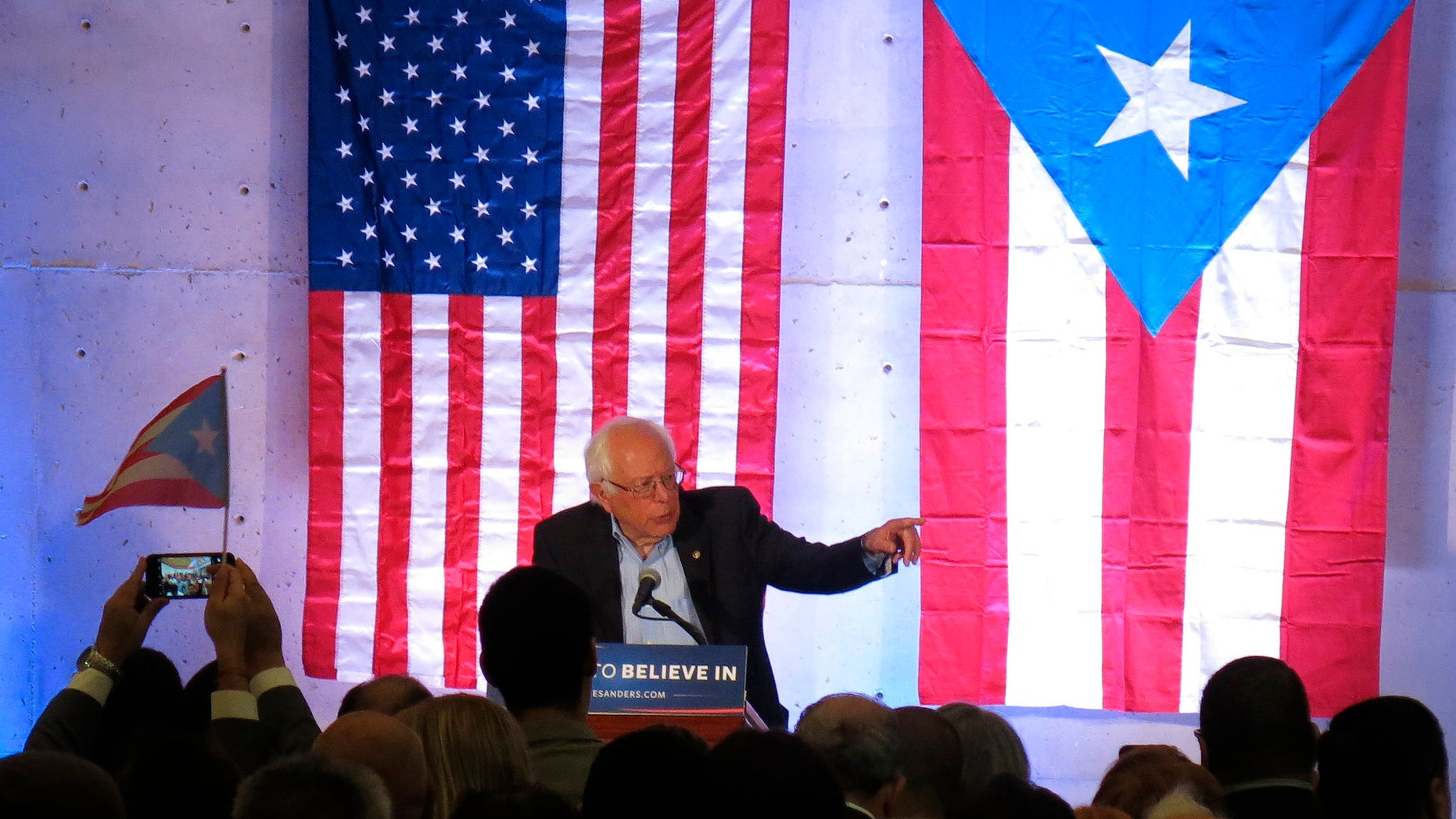 Democratic presidential candidate Sen. Bernie Sanders, I-Vt., holds a town hall meeting at the Luis Muñoz Marin Foundation in Trujillo Alto, Puerto Rico, Monday, May 16, 2016. Sanders arrived in Puerto Rico on Monday to talk about the U.S. territory's worsening debt crisis ahead of the June 5 primary. (AP Photo/Danica Coto)