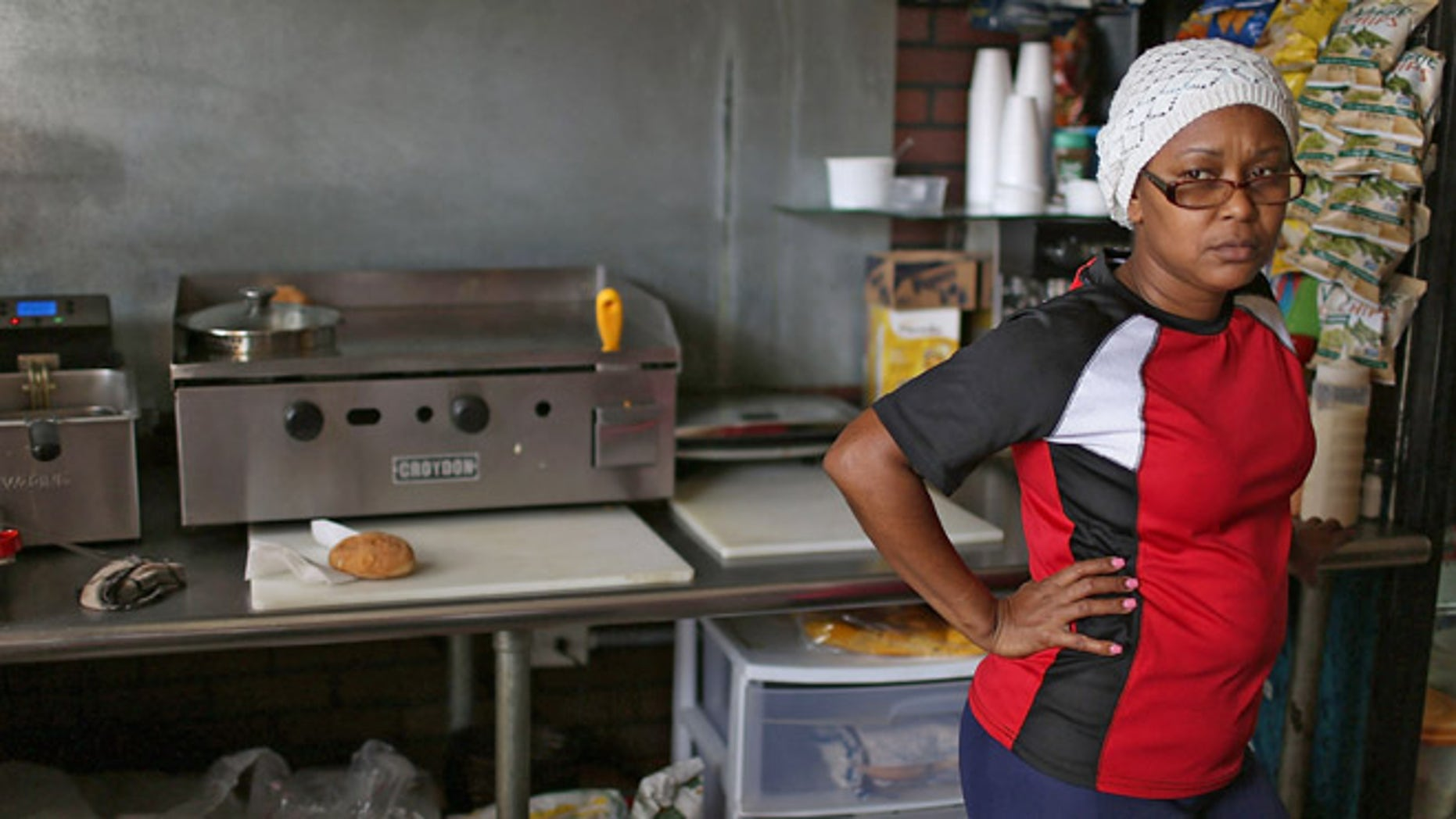 SAN JUAN, PUERTO RICO - JUNE 30:  Rosaura Guzman waits for customers at John Cafe a day after Puerto Rican Governor Alejandro Garcia Padilla gave a televised speech regarding the governments $72 billion debt on June 30, 2015 in San Juan, Puerto Rico.  The Governor said in his speech that the people will have to sacrifice and share in the responsibilities for pulling the island out of debt.  (Photo by Joe Raedle/Getty Images)