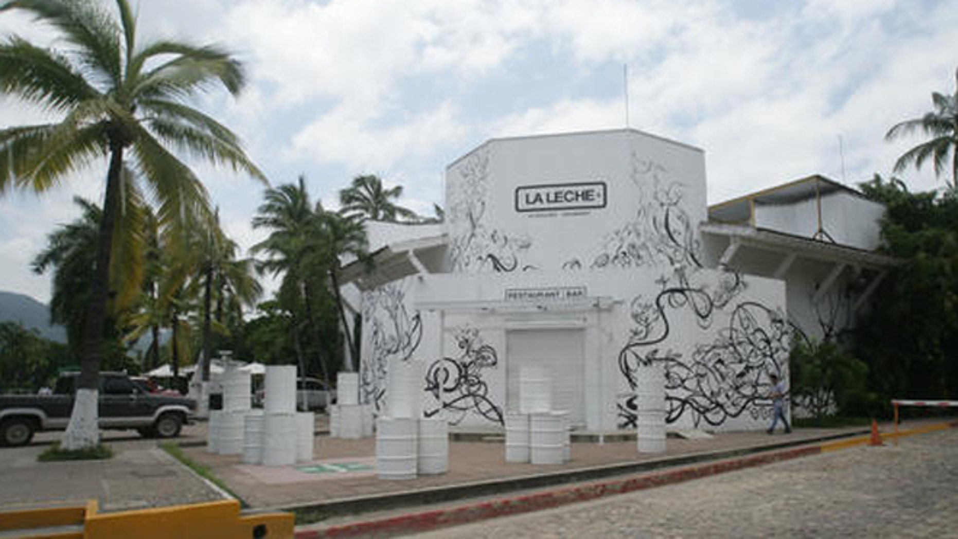 "The entrance of the restaurant ""La Leche"" stands closed after armed men abducted as many as 16 people who were dining in the upscale restaurant in Puerto Vallarta, Mexico, Monday, Aug. 15, 2016. Jalisco state prosecutor Eduardo Almaguer said in a news conference that preliminary results of the investigation indicate that all involved, kidnappers and kidnapped, were members of criminal organizations. (AP Photo/David Diaz)"