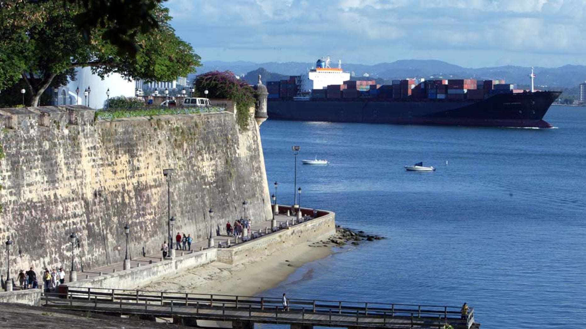 SAN JUAN, PUERTO RICO- APRIL 26: A ship passes past part of the wall that makes up La Fortaleza April 26, 2004 in Old San Juan, the original capital city of San Juan, Puerto Rico. Originally built as a fortress in 1533, it proved of limited military value but ideal for housing governors and dignitaries.The old city is a historic district of seven square blocks made up of ancient buildings and colonial homes, massive stone walls and vast fortifications, sunny parks and cobblestoned streets.  (Photo by Joe Raedle/Getty Images)