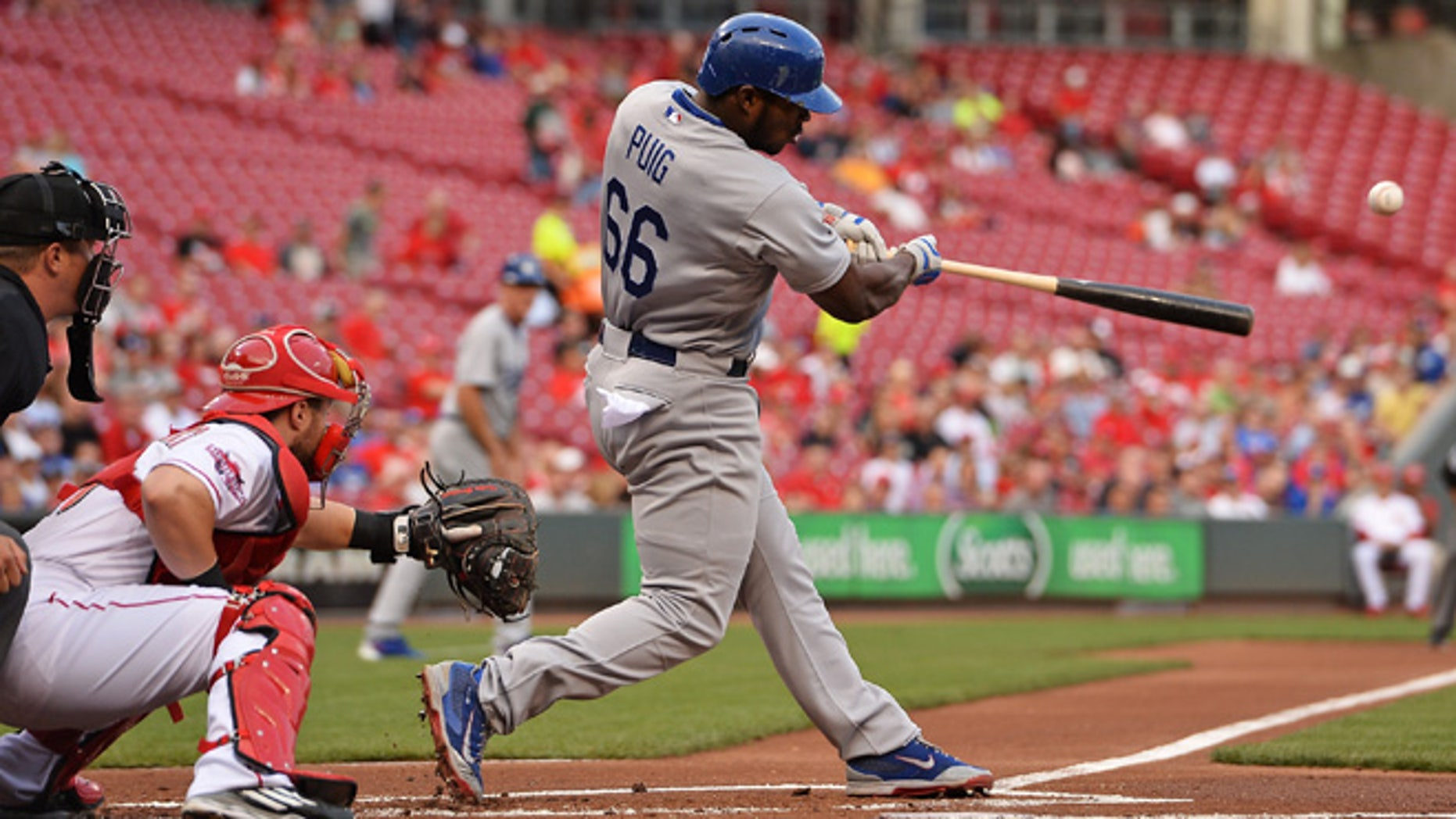 CINCINNATI, OH - AUGUST 25:  Yasiel Puig #66 of the Los Angeles Dodgers hits an RBI double in the first inning against the Cincinnati Reds at Great American Ball Park on August 25, 2015 in Cincinnati, Ohio.  (Photo by Jamie Sabau/Getty Images)
