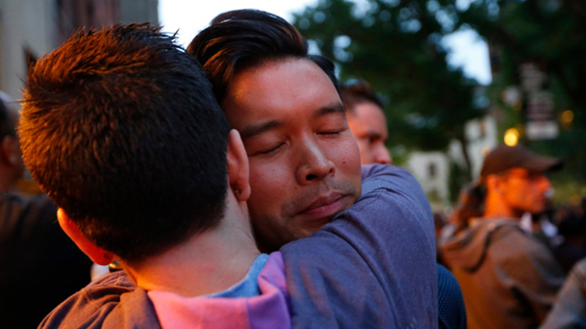 A vigil for victims of the Orlando nightclub shootings at the Stonewall Inn, a gay bar, Monday, June 13, 2016, in New York.