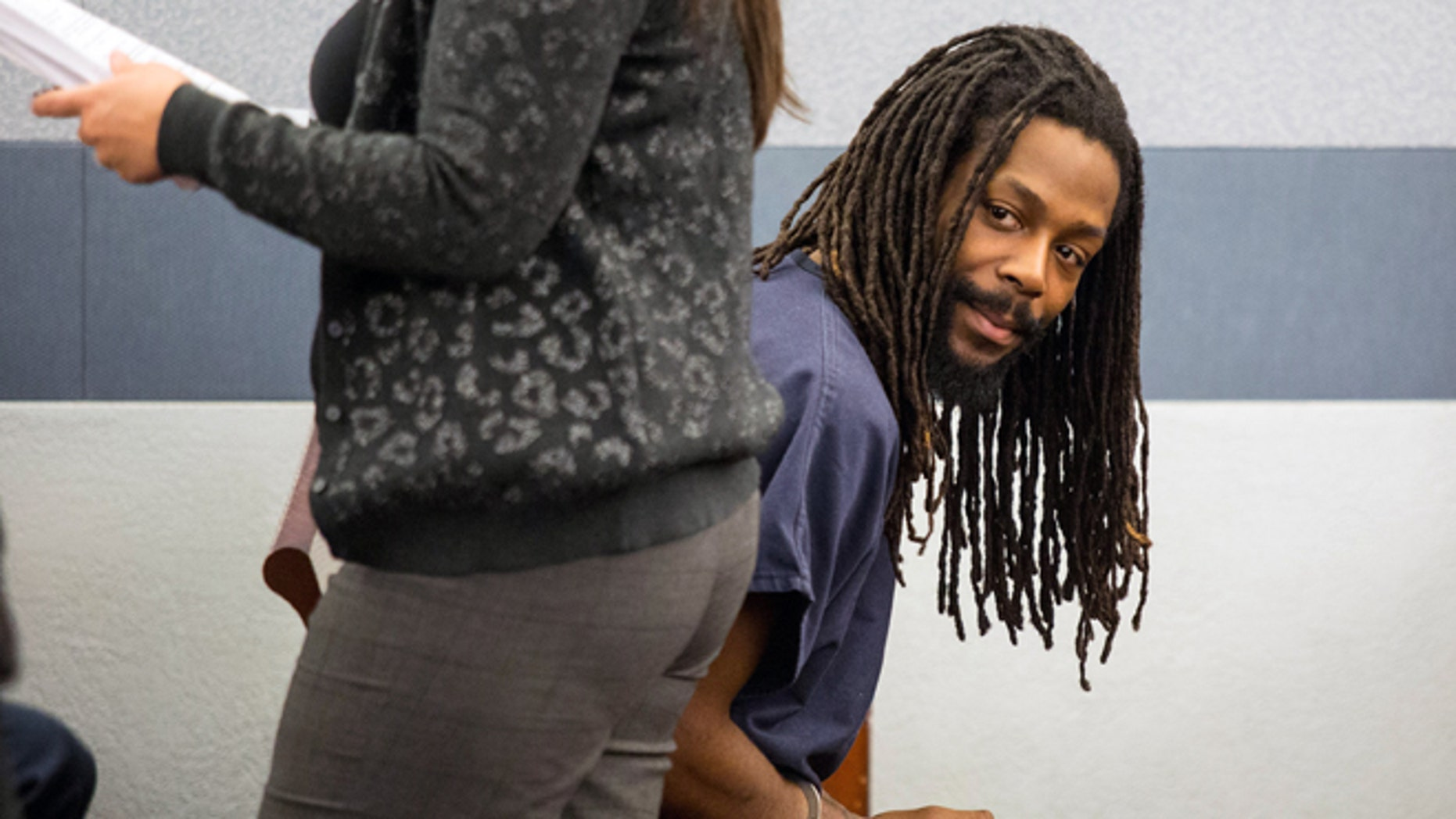 Feb. 21, 2014: Kirk Bills, 27, left, appears in court during his arrest warrant hearing at the Regional Justice Center in Las Vegas.
