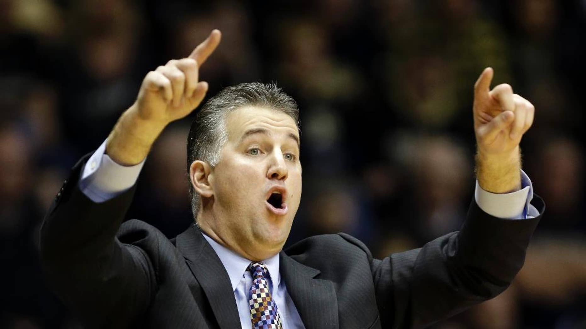 FILE - In this Jan. 12, 2014, file photo, Purdue head coach Matt Painter calls a play for his team as they play Nebraska in the second half of an NCAA college basketball game in West Lafayette, Ind. After losing 35 games over the past two seasons and finishing last in the Big Ten in 2013-14, Painter is going old-school. He wants to bring back the blue-collar, overachieving culture that made the Boilermakers so good for so many years.  (AP Photo/Michael Conroy, File)