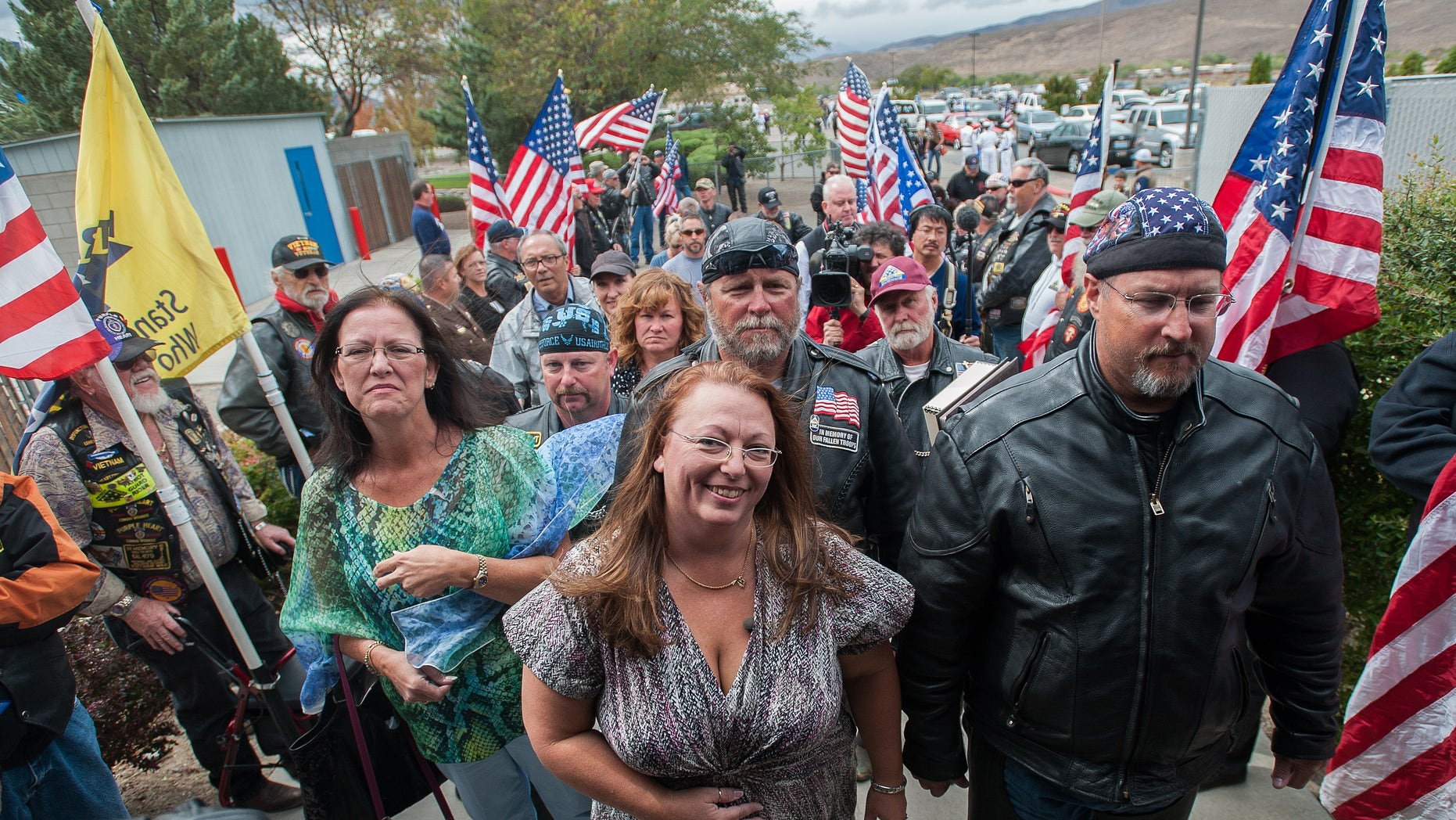 Sept. 21, 2013: Donna Gregory of St. Louis and members of the Patriot Guard wait to enter Dayton Intermediate School to give Peggy Eddington-Smith, 69, of Dayton, Nev., recently found personal items of her father, Pfc. John Eddington of Leadwood, Mo., in Dayton, Nev.