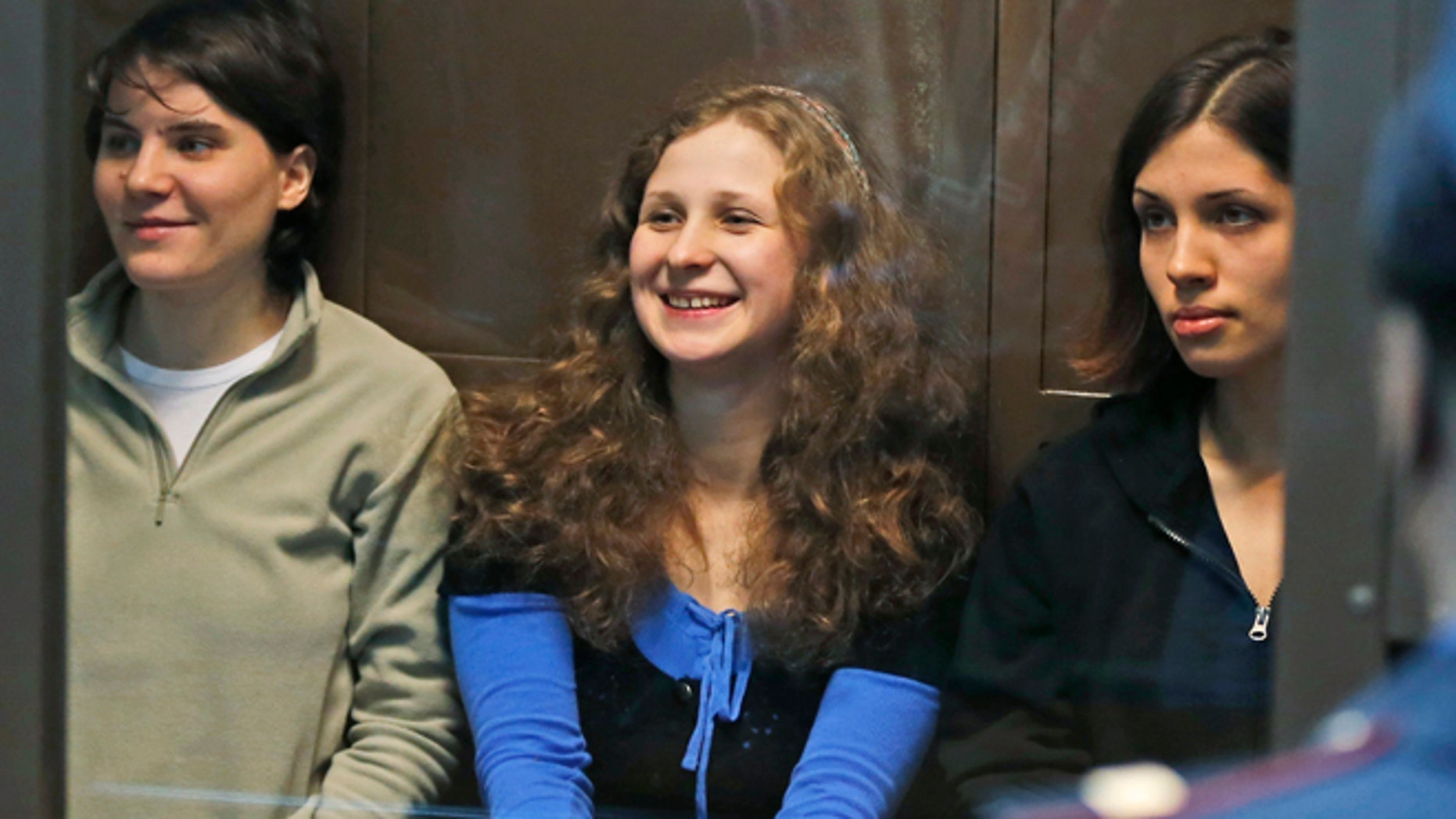 FILE 2012: Pussy Riot singer Maria Alekhina, center, was moved into a solitary cell following tension with other inmates.