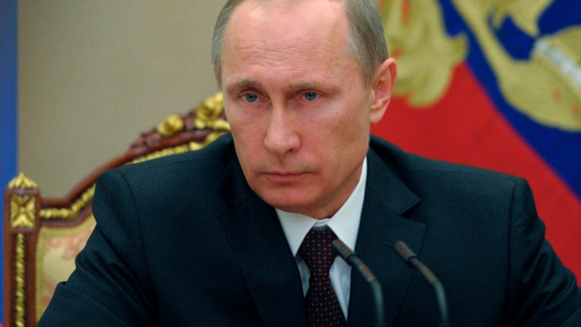 """March 21: Vladimir Putin hailed the incorporation of Crimea into Russia as a """"remarkable event"""" before he signed the bills into law in the Kremlin."""