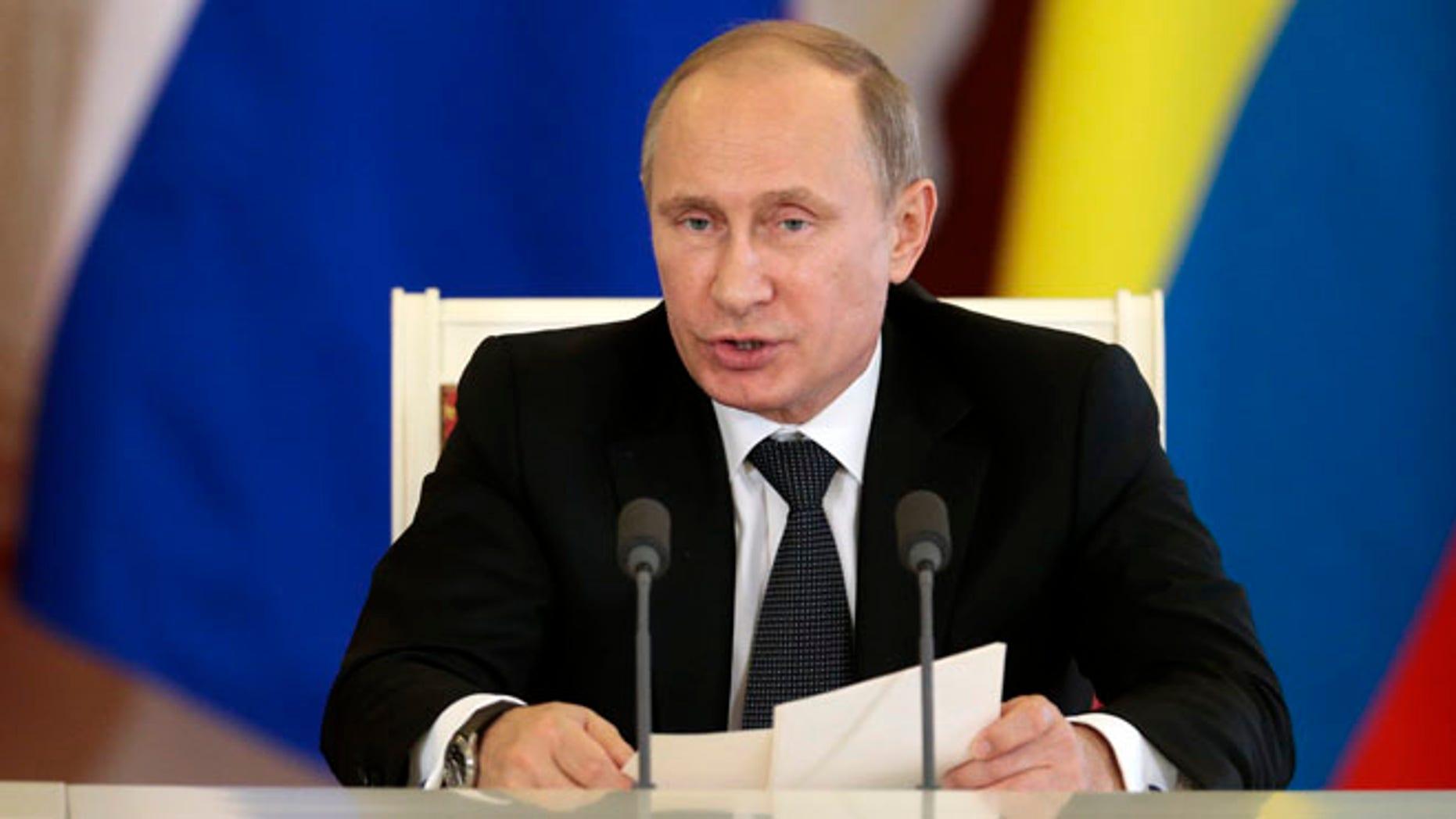 Russian President Vladimir Putin speaks in Moscow's Kremlin, Russia, on Tuesday, Oct. 29, 2013.