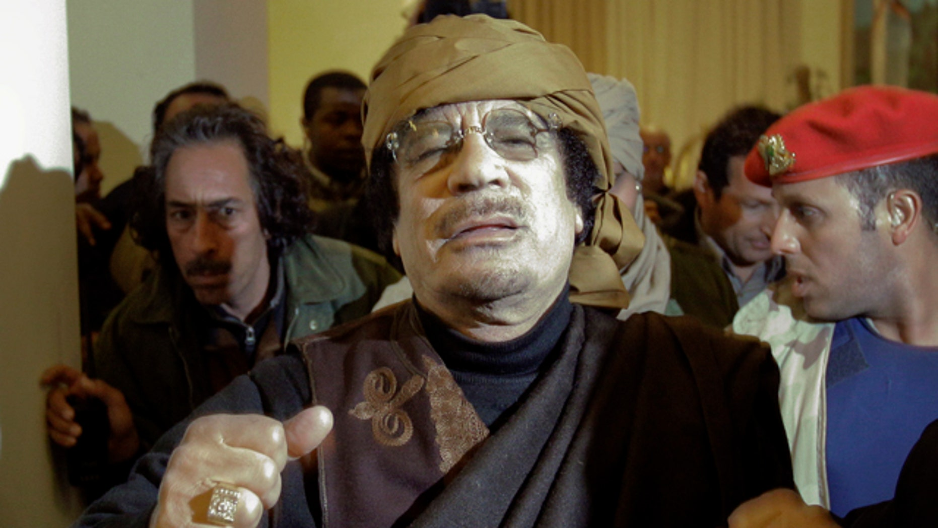 March 8: Libyan Leader Muammar Qaddafi arrives at a hotel to give television interviews in Tripoli, Libya.