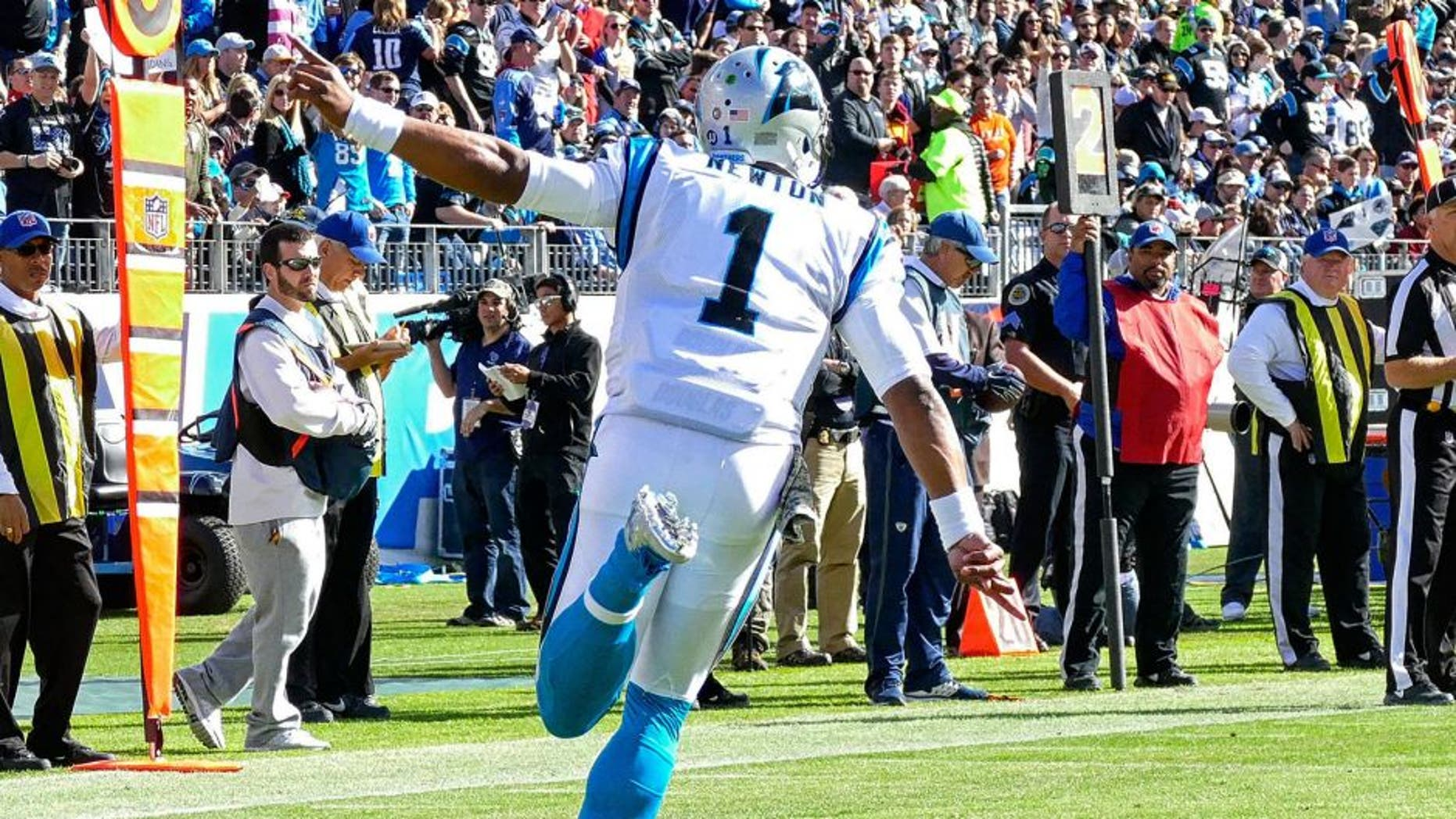 NASHVILLE, TN - NOVEMBER 15: Quarterback Cam Newton #1 of the Carolina Panthers celebrates after a touchdown against of the Tennessee Titans at Nissan Stadium on November 15, 2015 in Nashville, Tennessee. (Photo by Frederick Breedon/Getty Images)