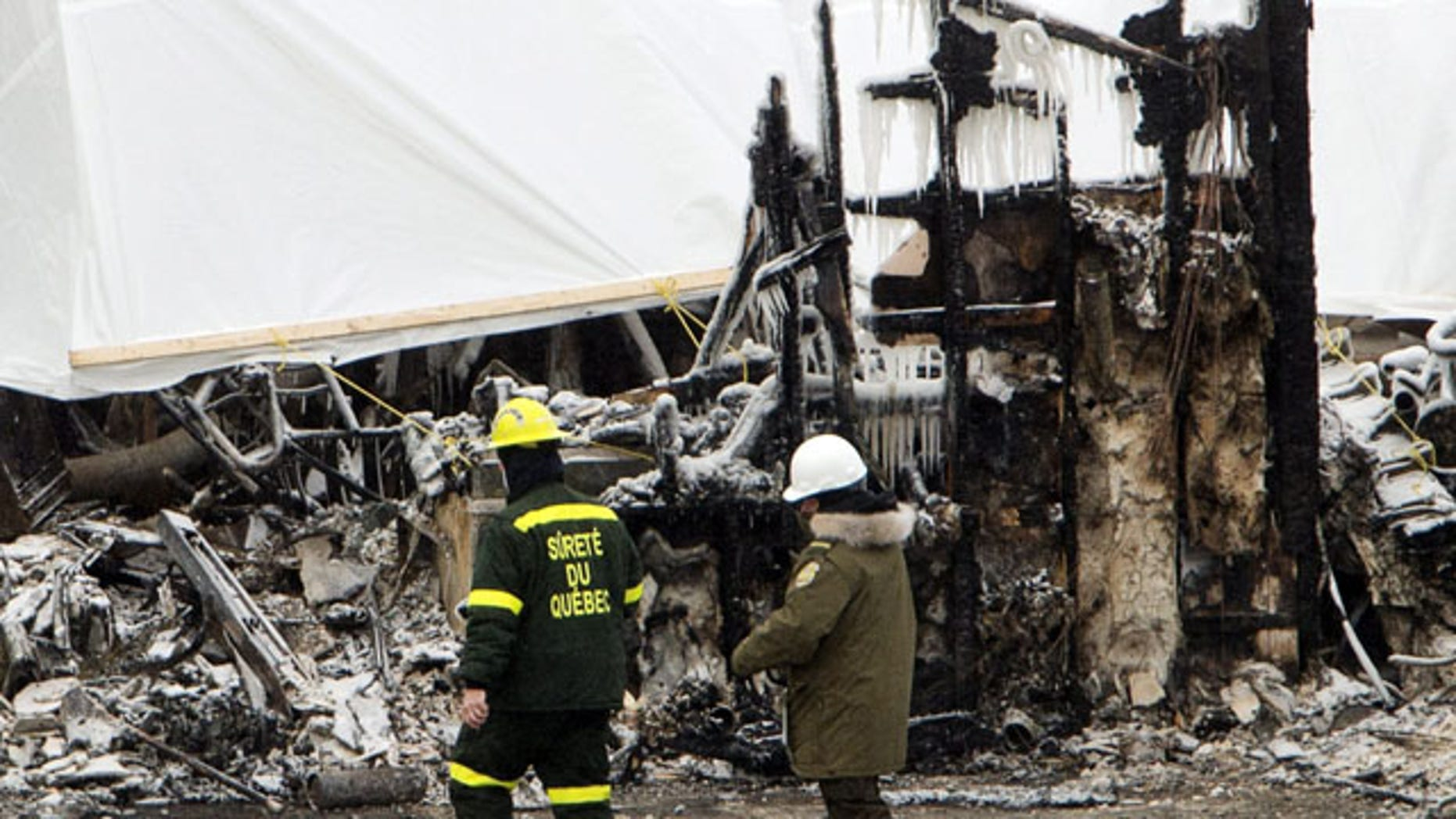 January 25, 2014: Emergency workers continue the search for victims  in L'Isle-Verte, Quebec, at the scene of Thursday's fatal fire at a seniors residence. (AP Photo/The Canadian Press, Ryan Remiorz)