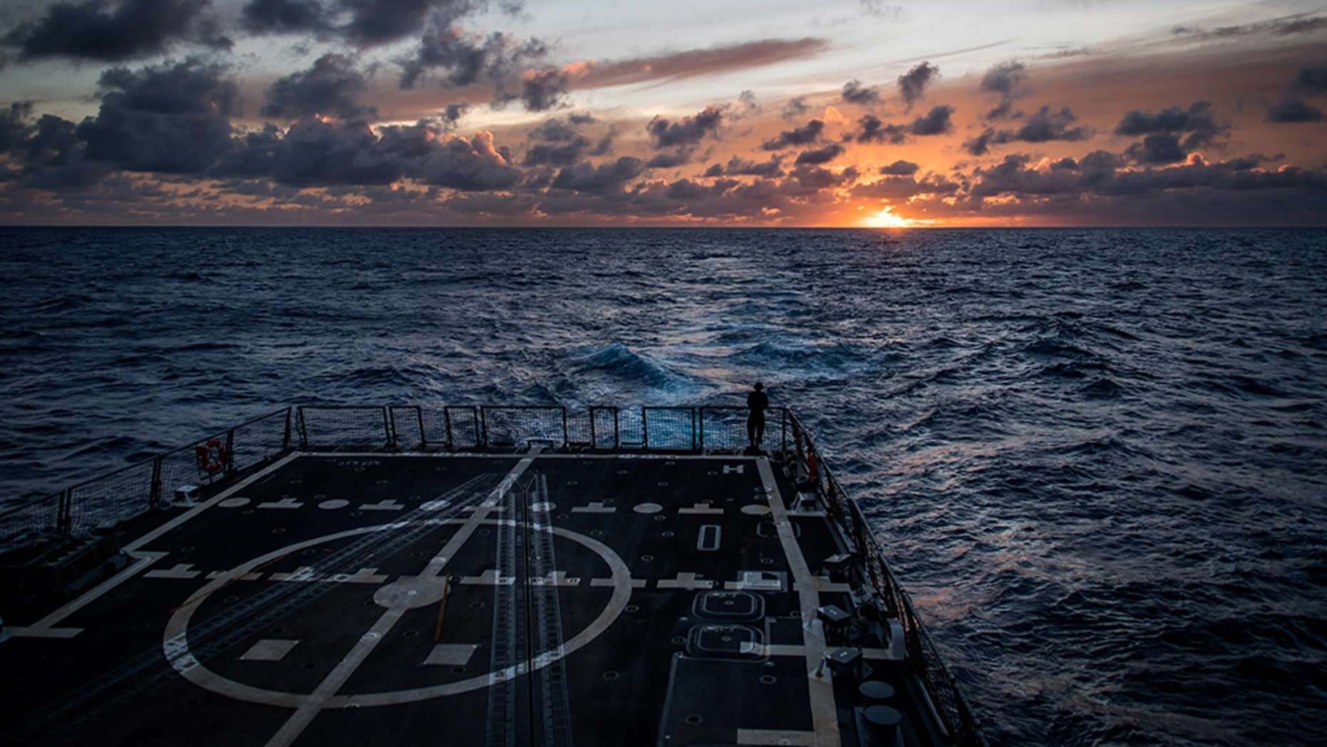 The guided-missile destroyer USS Dewey (DDG 105) transits the Pacific Ocean while participating in the 2018 Rim of the Pacific (RIMPAC) exercise.
