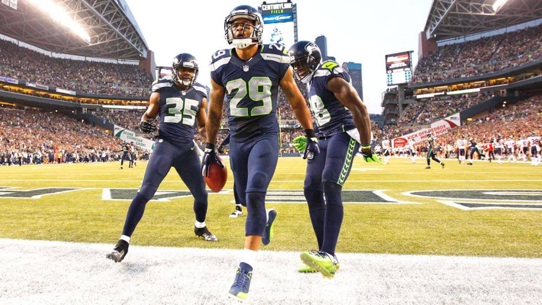 Aug 22, 2014; Seattle, WA, USA; Seattle Seahawks free safety Earl Thomas (29) celebrates after a 59-yard punt return against the Chicago Bears during the second quarter at CenturyLink Field. Mandatory Credit: Joe Nicholson-USA TODAY Sports