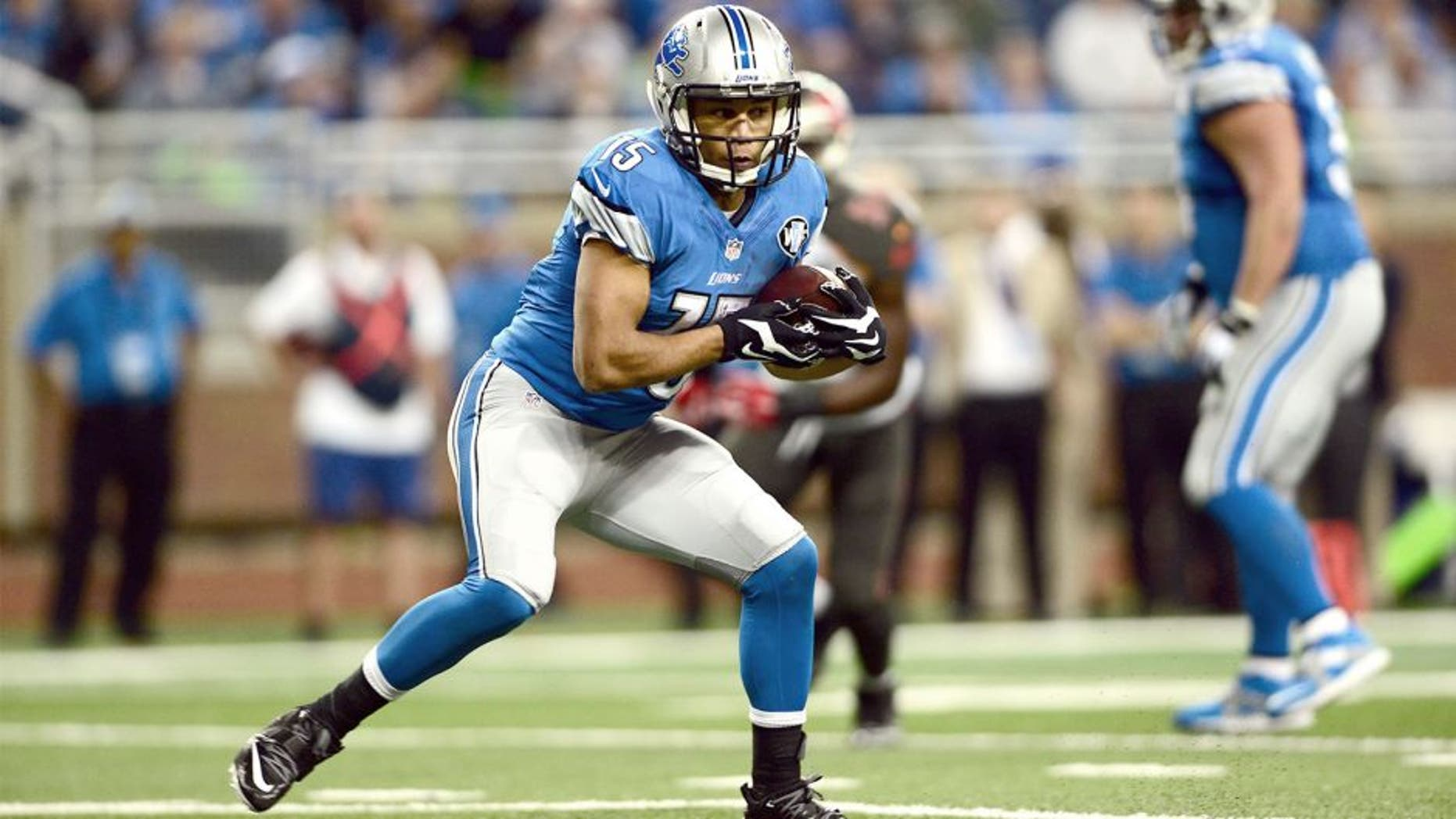 Dec 7, 2014; Detroit, MI, USA; Detroit Lions wide receiver Golden Tate (15) makes a catch and looks to get vertical during the first quarter against the Tampa Bay Buccaneers at Ford Field. Mandatory Credit: Andrew Weber-USA TODAY Sports
