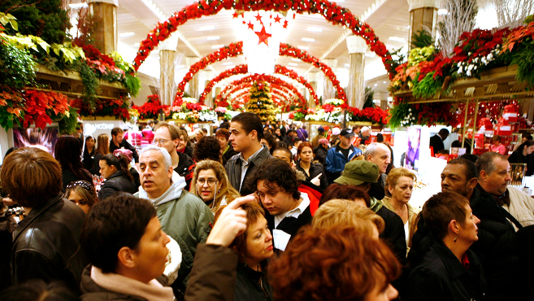 Shoppers fight the holiday crowds at Macy's at Herald Square in New York.