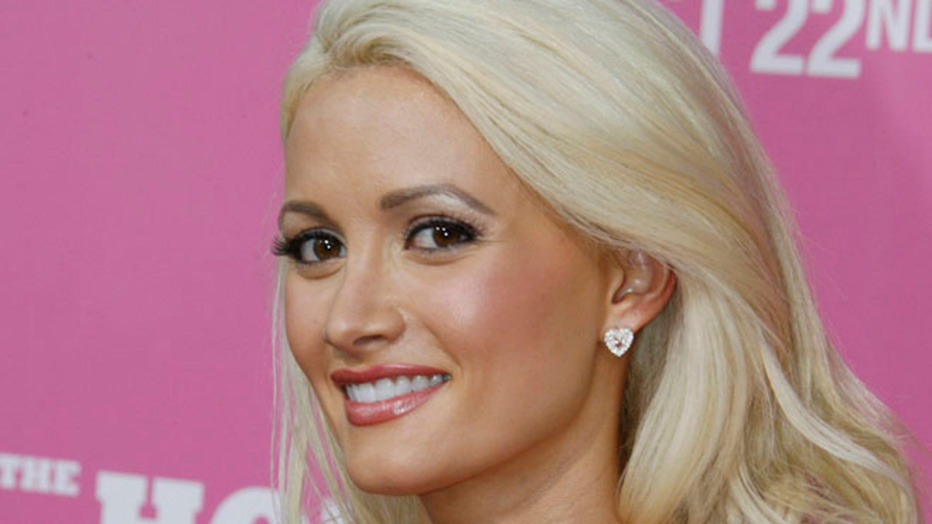 "Aug. 20, 2008: Playboy Playmate Holly Madison, cast member of the comedy film ""The House Bunny"",  poses at the film's premiere in Los Angeles."