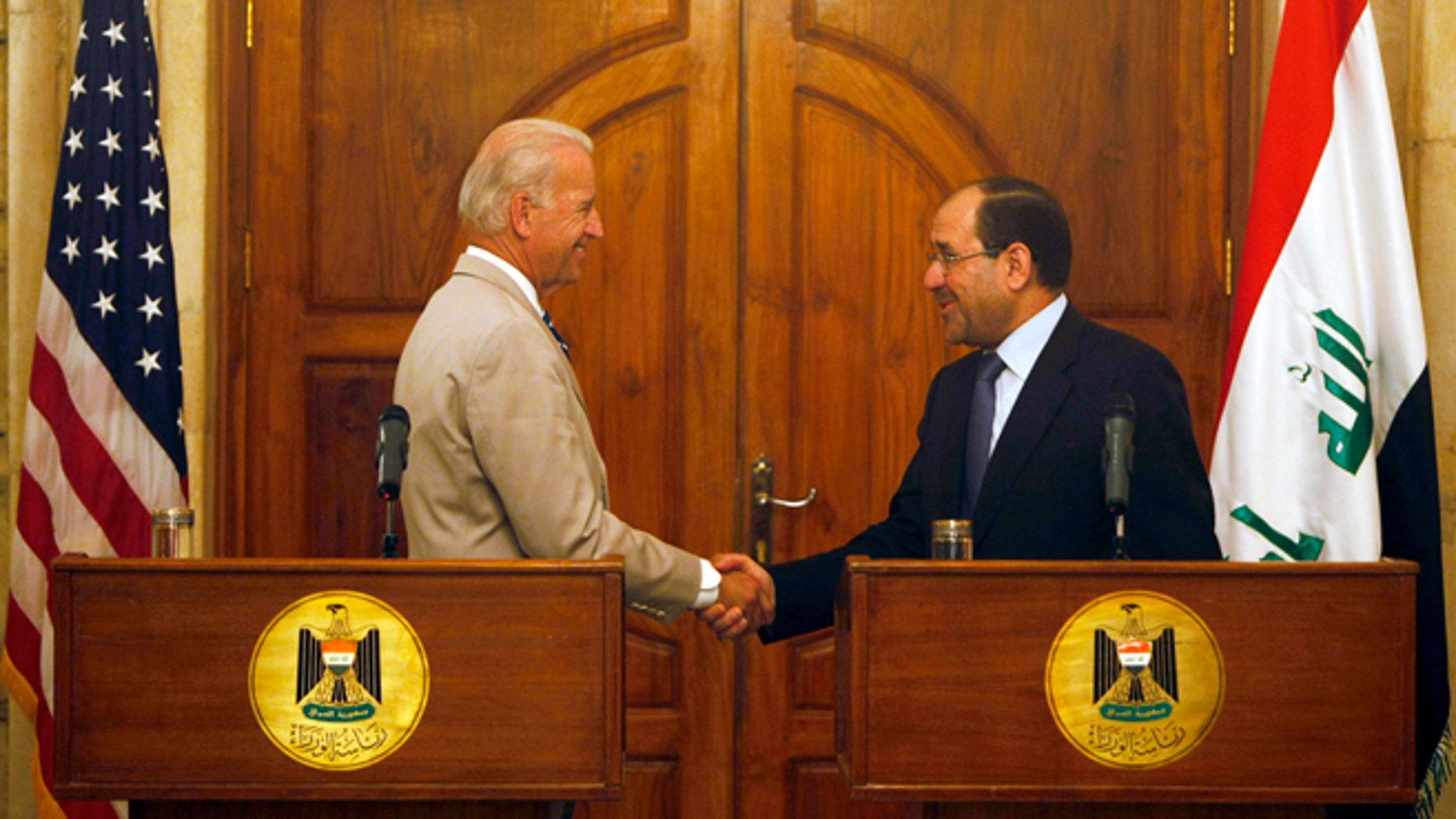 U.S. Vice President Joseph Biden and Iraqi Prime Minister Nuri al-Maliki (R) shake hands in Baghdad July 3, 2009.