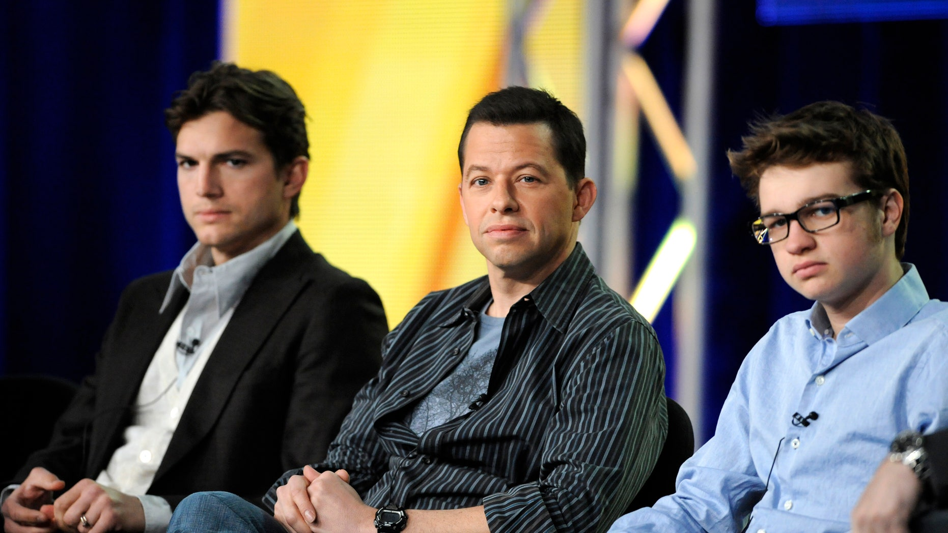 """Jan. 11, 2012: Cast members Ashton Kutcher (L), Jon Cryer (C) and Angus T. Jones (R) participate in a panel for CBS series """"Two and a Half Men"""" during the CBS sessions at the Television Critics Association winter press tour in Pasadena, Calif."""
