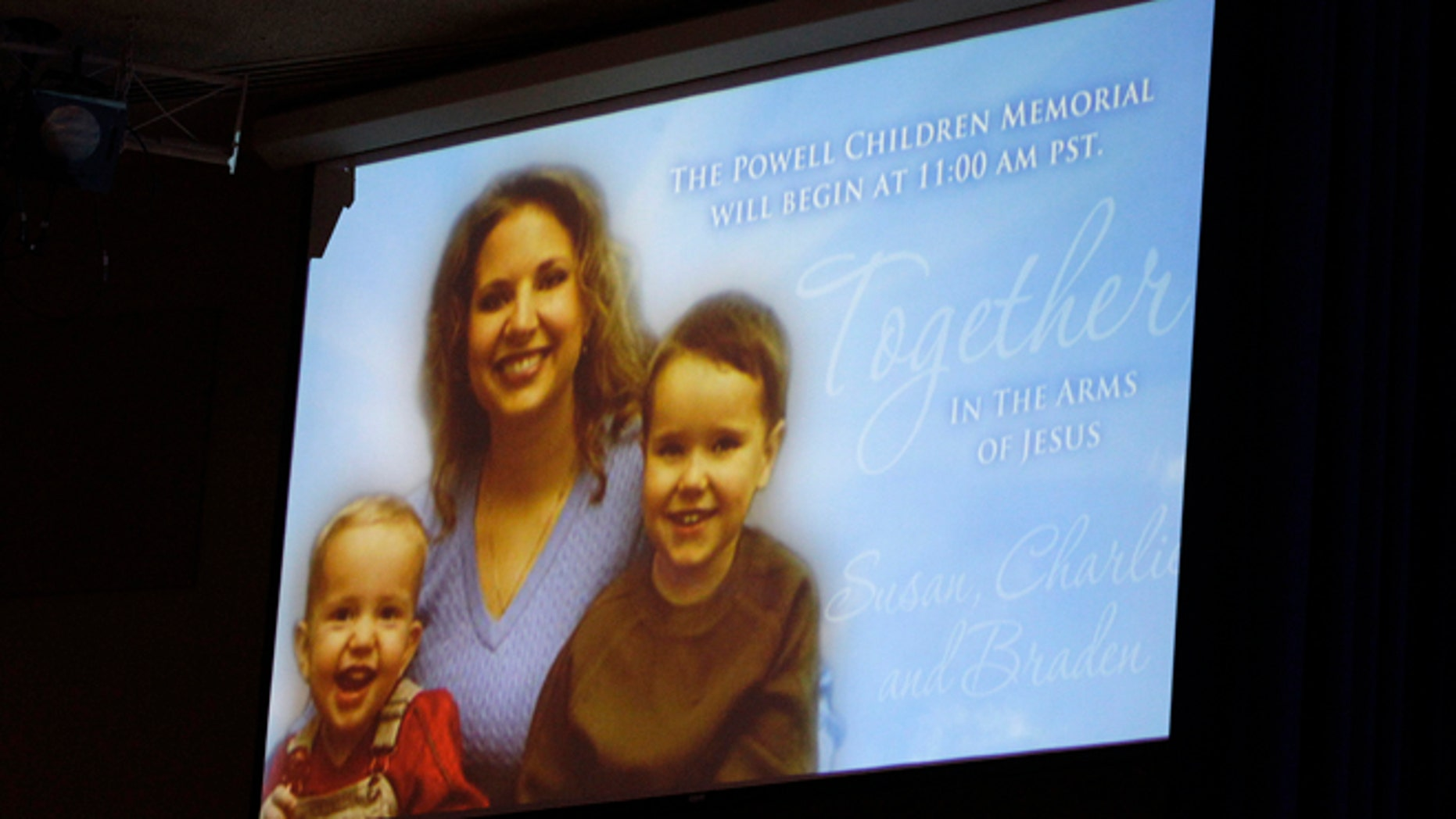 A picture of Susan Powell is seen on a screen with her children Charles (R) and Braden Powell during funeral services for the boys in Tacoma, Wash., Feb. 11, 2012.