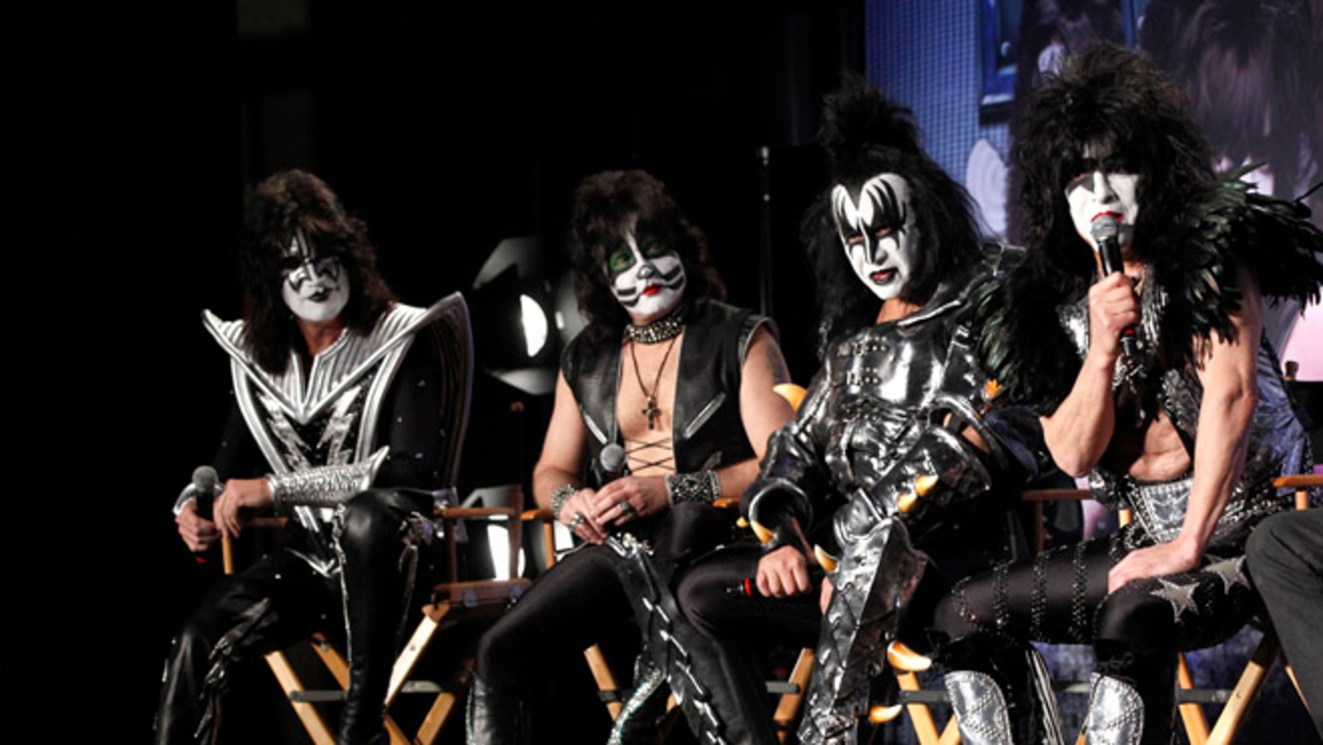 """March 20, 2012: Rock band Kiss (from L-R) Tommy Thayer, Eric Singer, Gene Simmons and Paul Stanley attend a news conference to announce the """"Kiss, Motley Crue: The Tour"""" in Hollywood, California."""