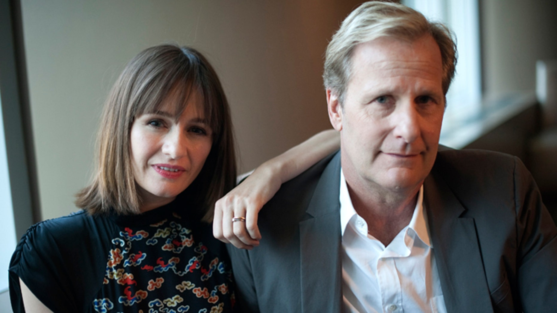 May 17, 2012: Cast members Emily Mortimer and Jeff Daniels (R) pose for a photo at the offices of HBO in New York.