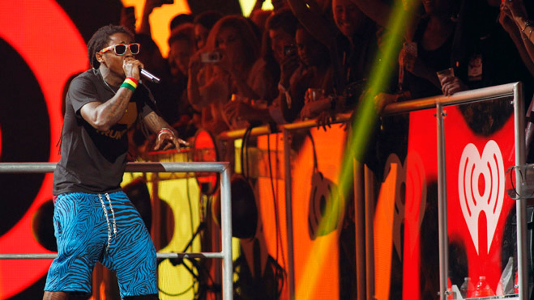 Sept. 21, 2012: Rapper Lil Wayne performs during the 2012 iHeart Radio Music Festival at the MGM Grand Garden Arena in Las Vegas, Nevada.