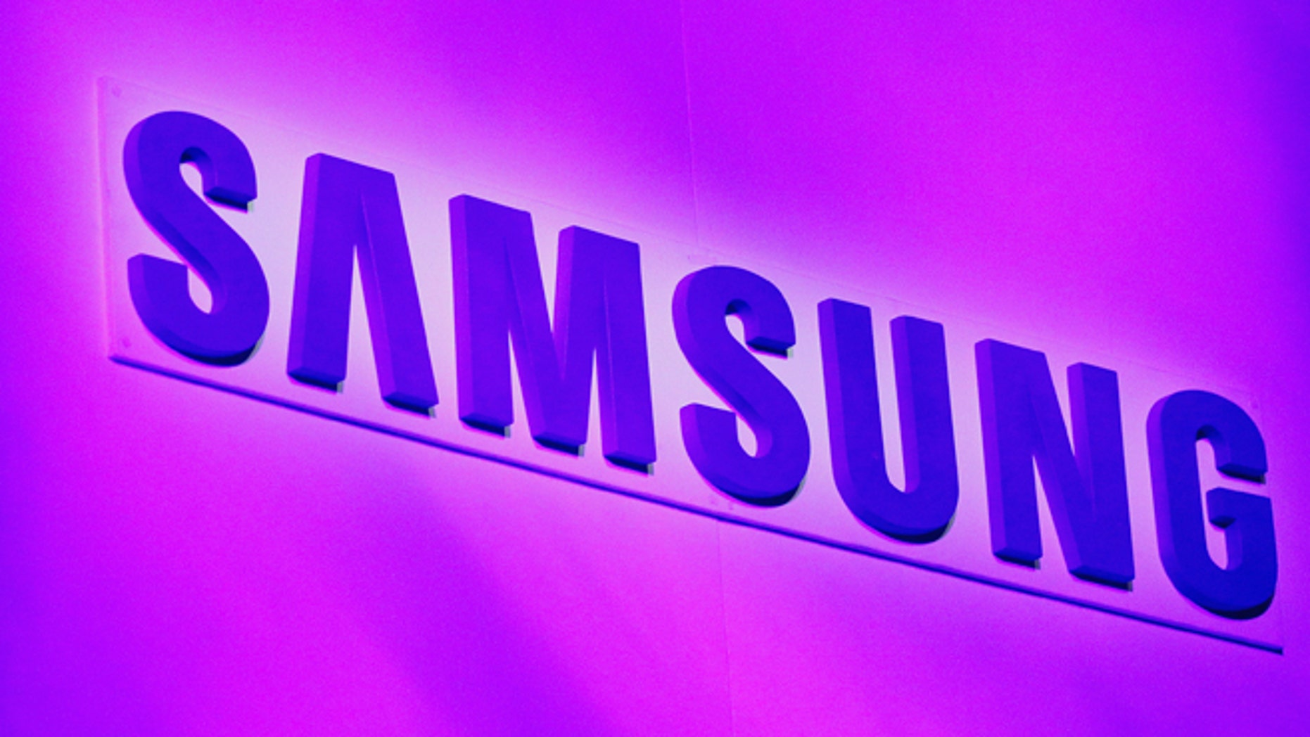 The company logo is displayed at the Samsung news conference at the Consumer Electronics Show (CES) in Las Vegas January 7, 2013.
