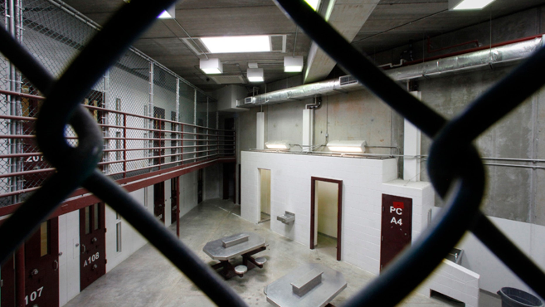 The interior of an unoccupied communal cellblock is seen at Camp VI, a prison used to house detainees at the U.S. Naval Base at Guantanamo Bay.