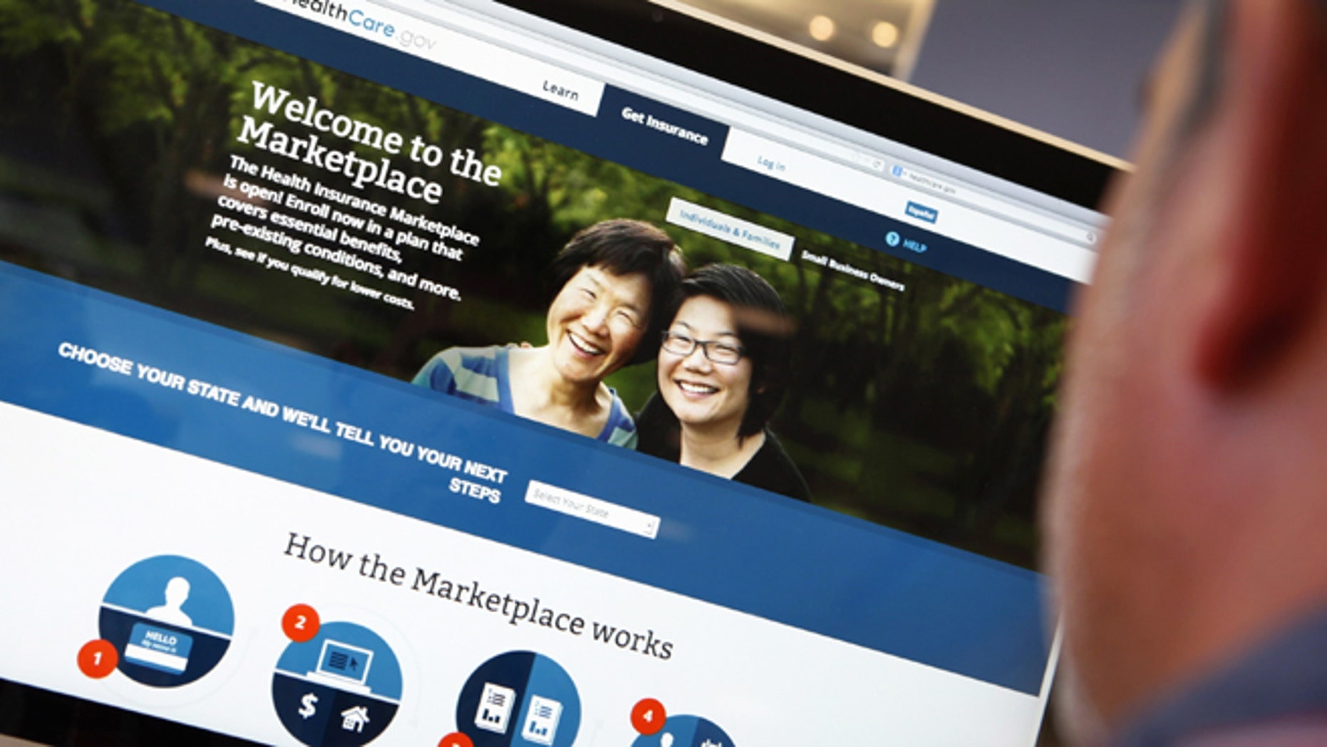 A man looks over the Affordable Care Act (commonly known as Obamacare) signup page on the HealthCare.gov website.
